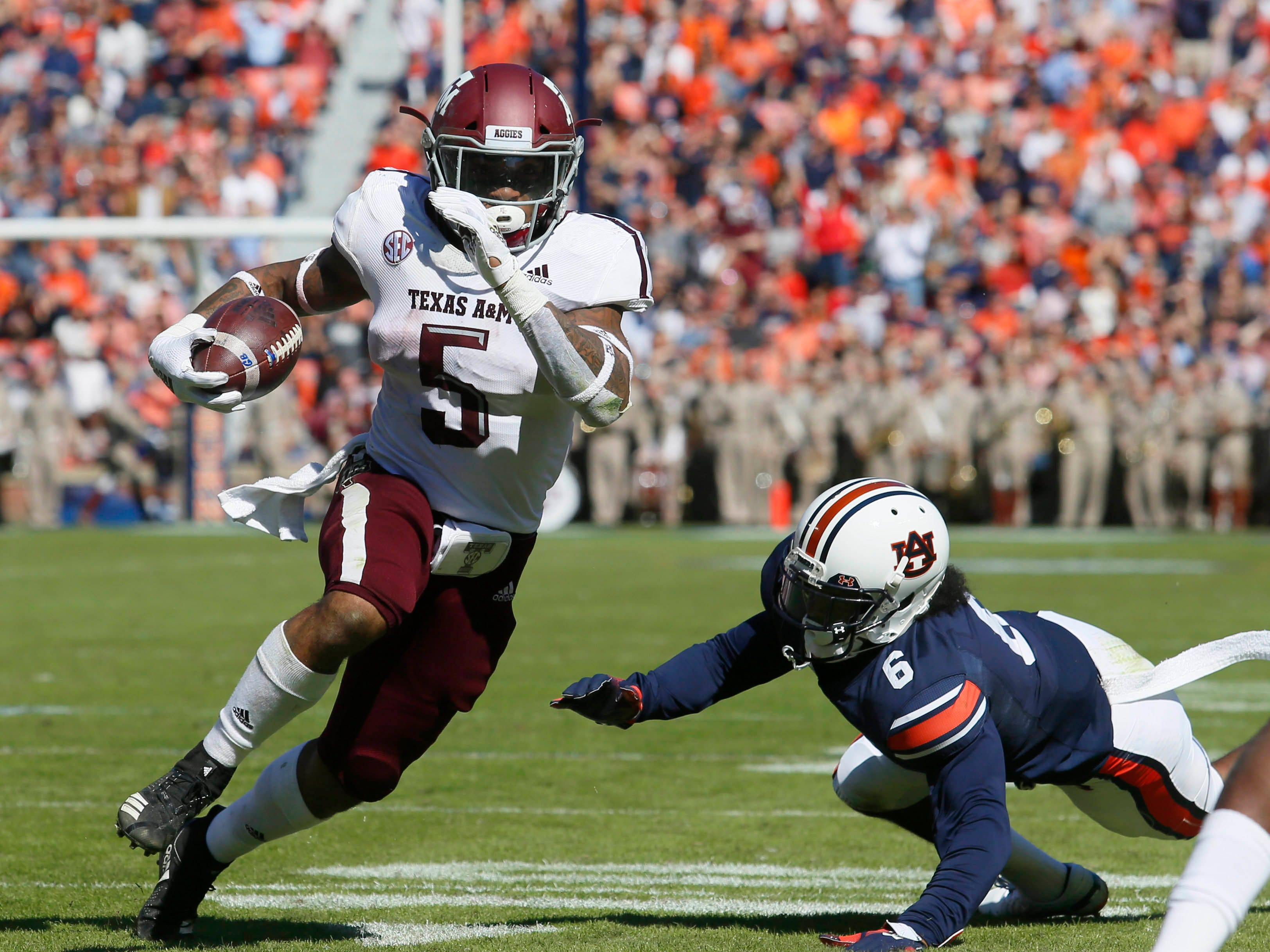 Texas A&M Aggies running back Trayveon Williams (5) scores a first-half touchdown at Auburn's Jordan-Hare Stadium.