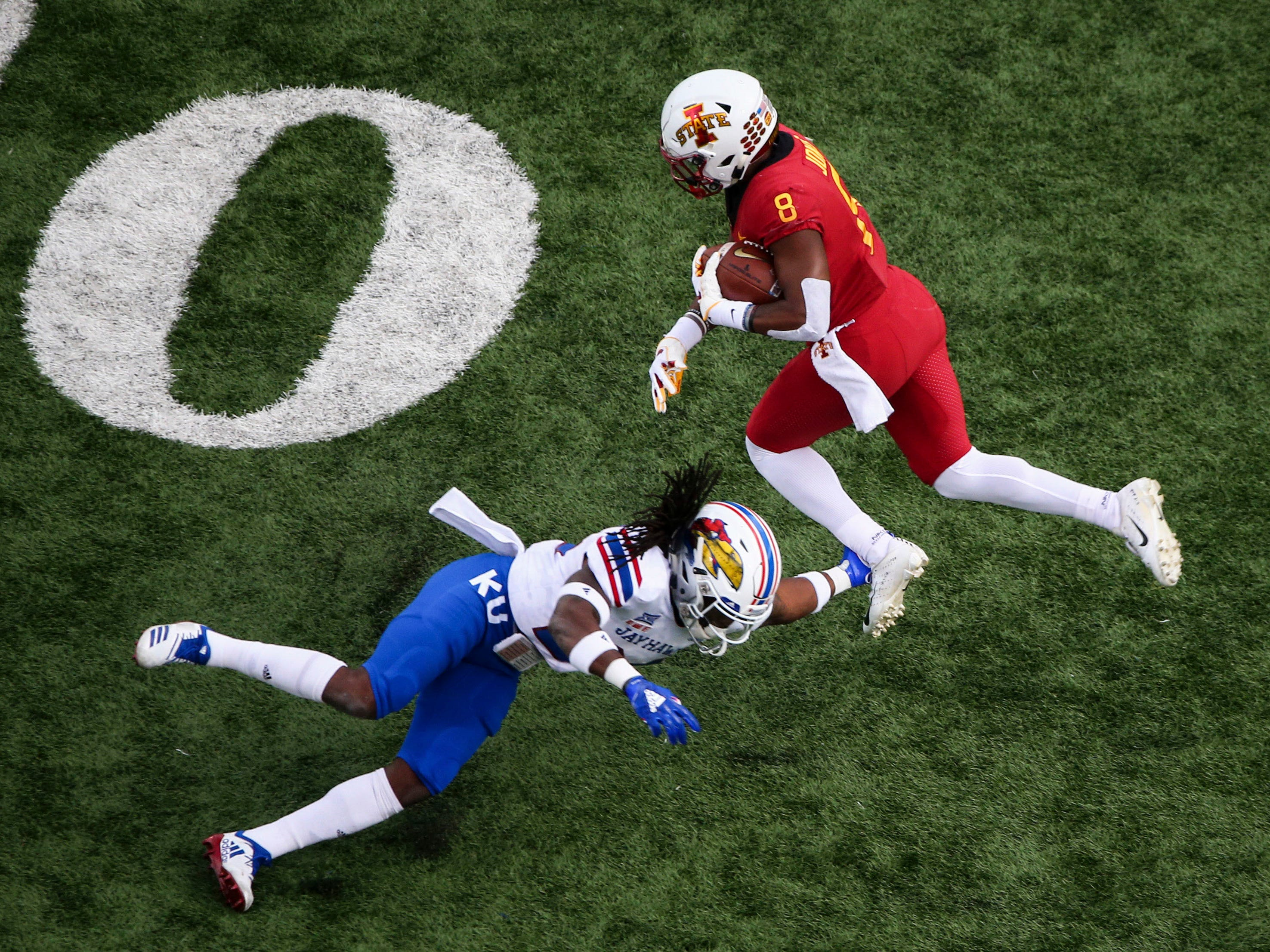 Iowa State Cyclones wide receiver Deshaunte Jones (8) tries to evade Kansas Jayhawks cornerback Ricky Thomas (24) in the second half at Memorial Stadium.