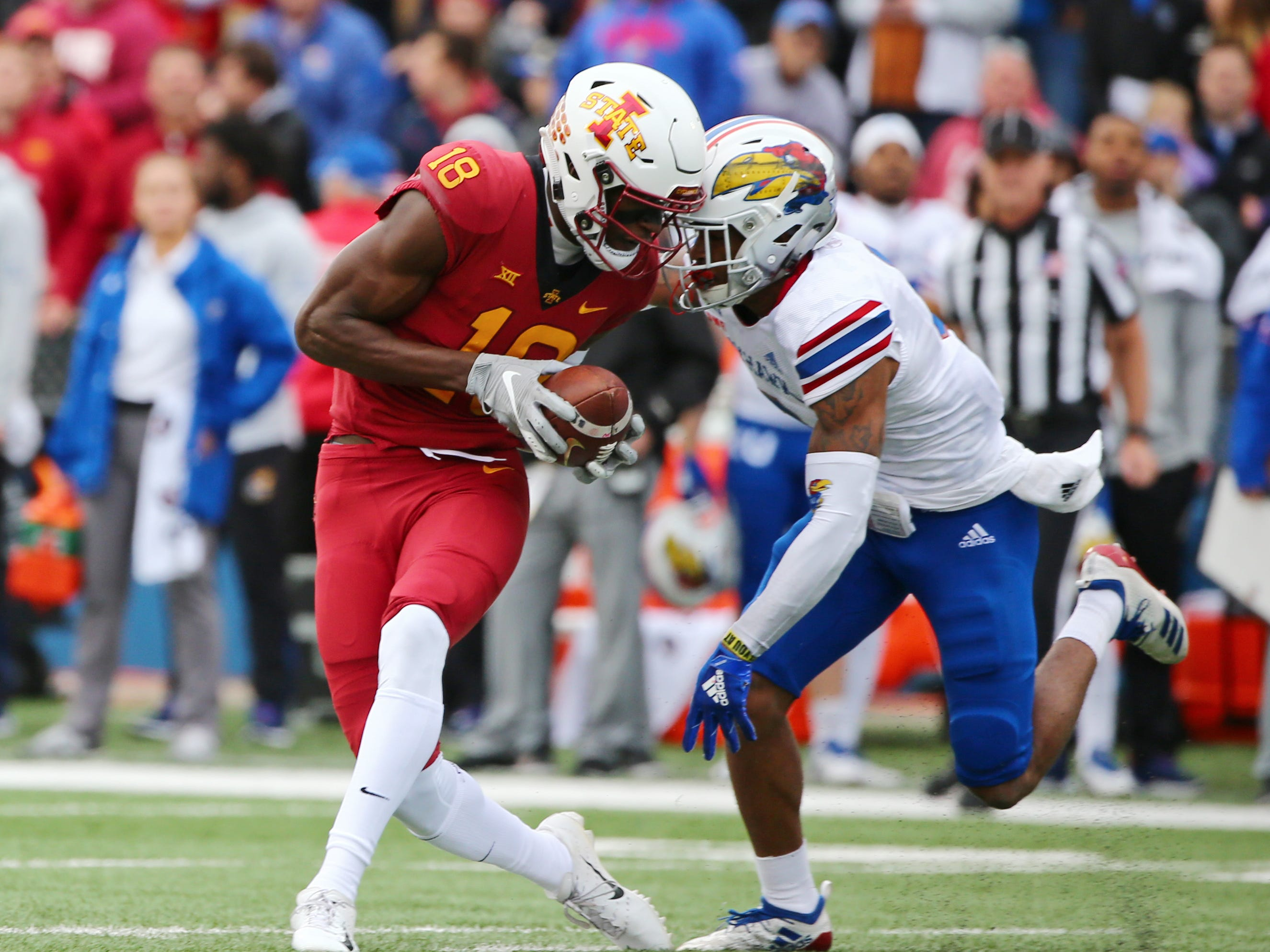 Iowa State Cyclones wide receiver Hakeem Butler (18) catches a pass for a touchdown against Kansas Jayhawks wide receiver Evan Fairs in the first half at Memorial Stadium.