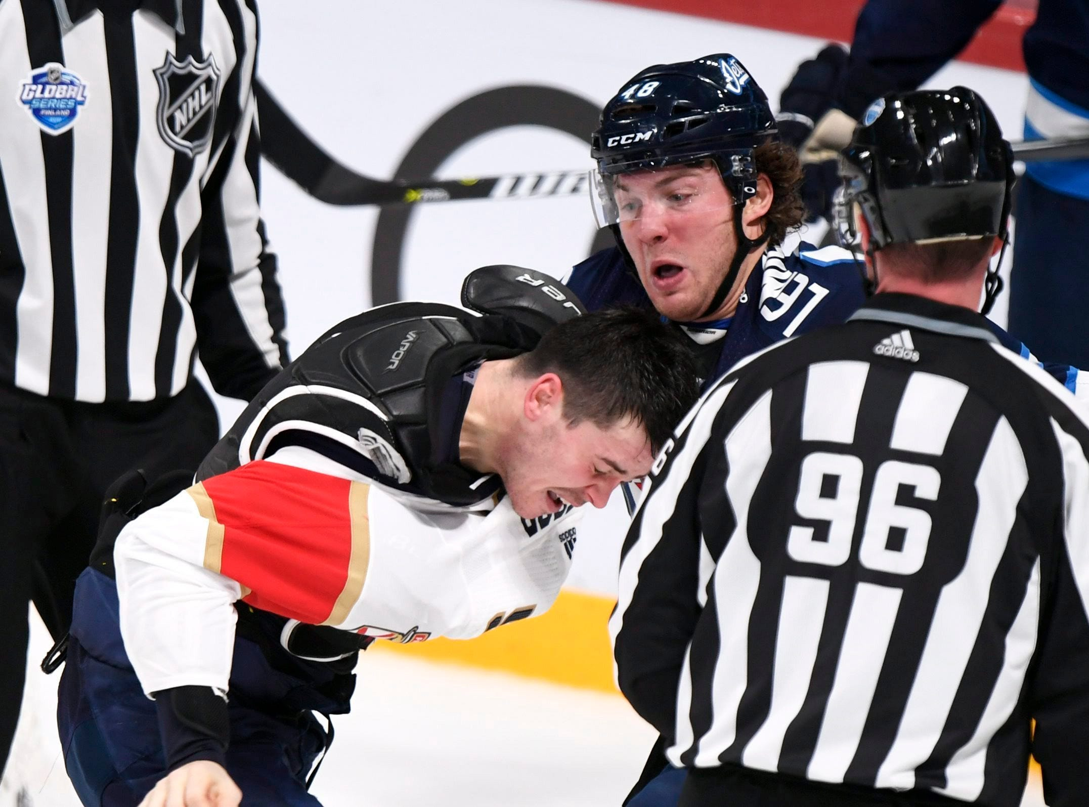Nov. 2: MacKenzie Weegar, Panthers, left, vs. Brendan Lemieux, Jets
