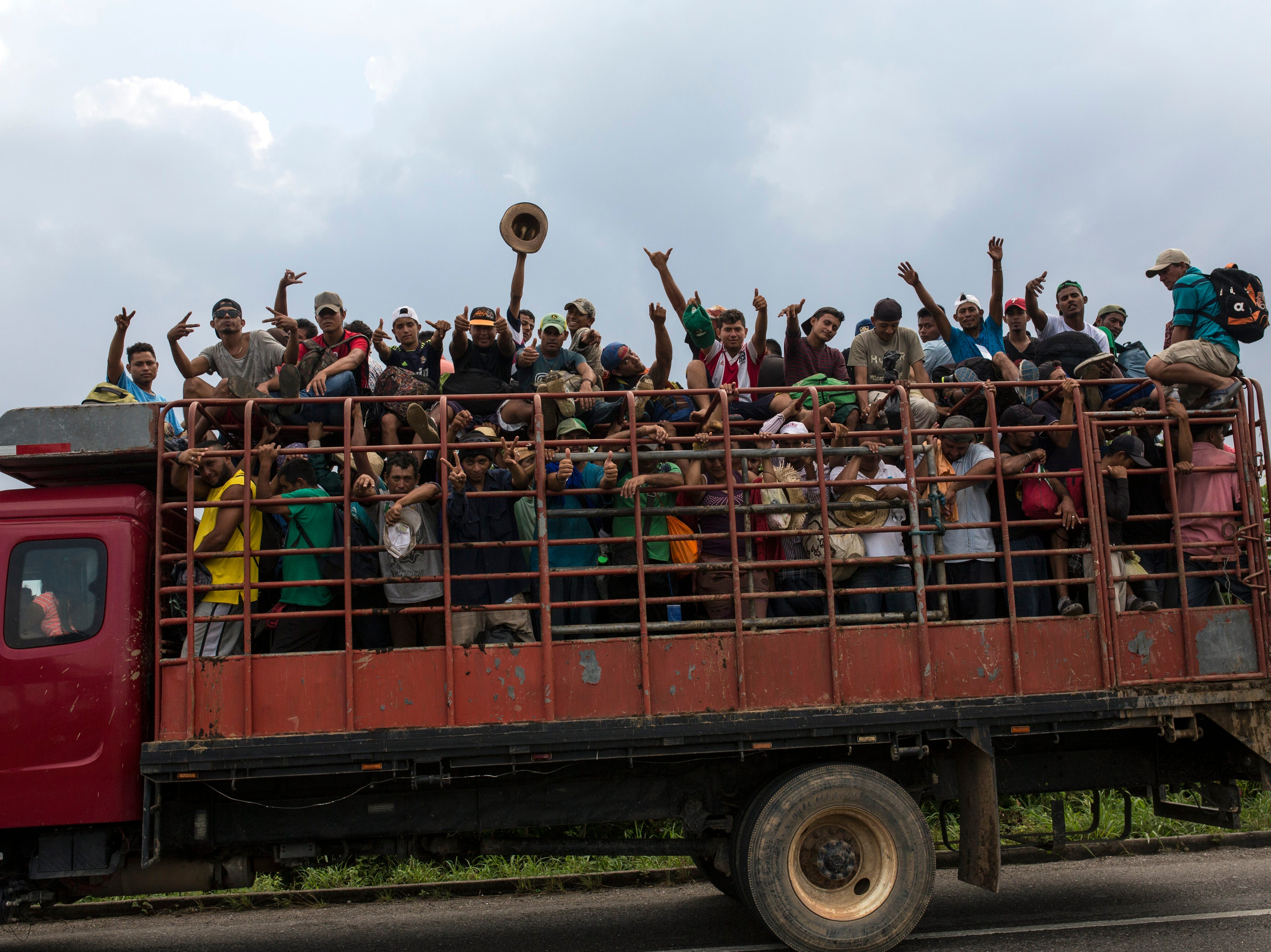 Central American migrants, part of the caravan hoping to reach the U.S. border, get a ride on a truck in Donaji, Oaxaca state, Mexico, Friday, Nov. 2, 2018. The migrants had already made a grueling 40-mile trek from Juchitan, Oaxaca, on Thursday, after they failed to get the bus transportation they had hoped for. But hitching rides allowed them to get to Donaji early, and some headed on to a town even further north, Sayula.