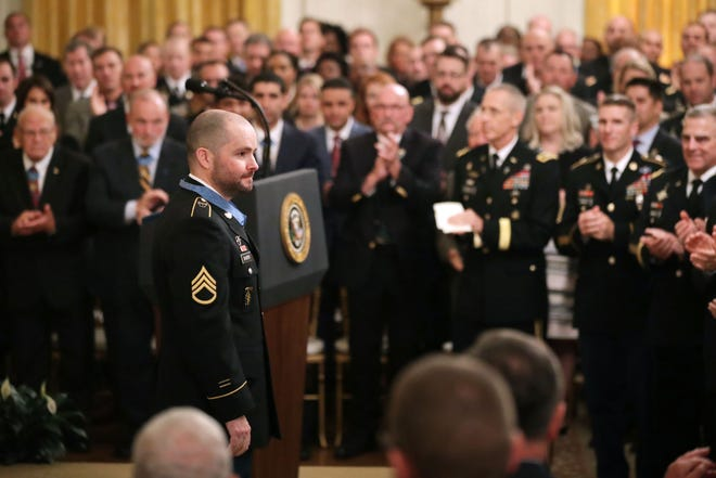 Staff Sgt. Ronald J. Shurer II receives a standing ovation after being awarded the Medal of Honor in October 2018. Shurer, who died in May, will be buried today in Arlington National Cemetery.