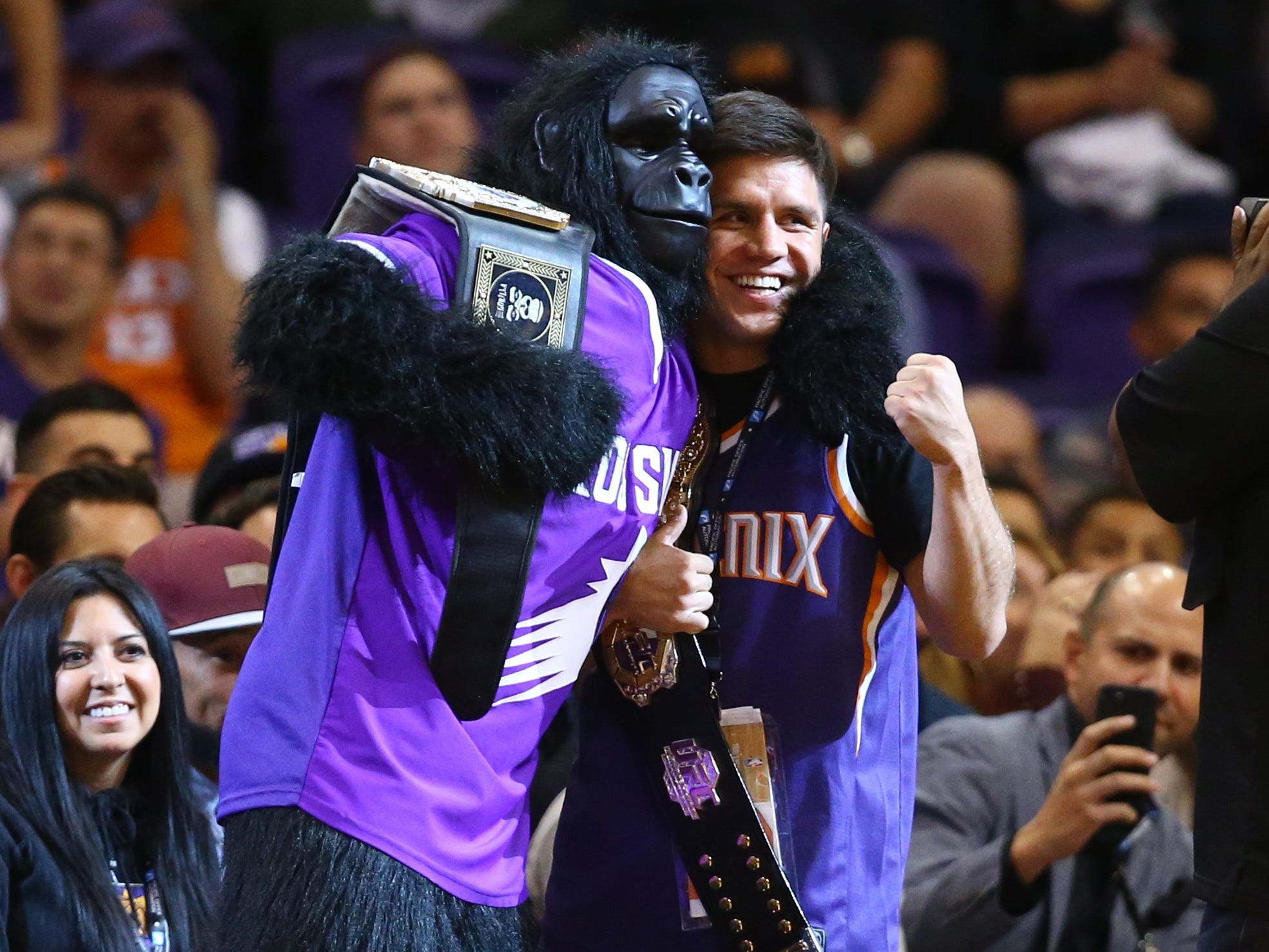 Nov. 2: UFC flyweight champion Henry Cejudo, who is based in Phoenix, poses with the Suns Gorilla at Talking Stick Resort Arena.