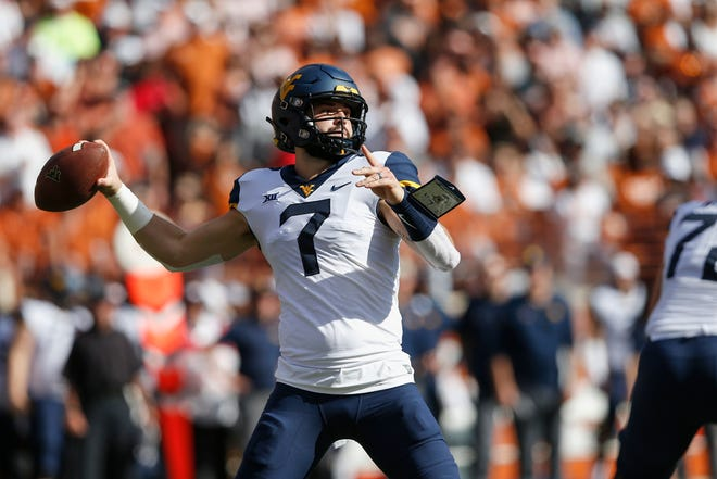 Will Grier of the West Virginia Mountaineers looks to pass in the first quarter against the Texas Longhorns at Darrell K Royal-Texas Memorial Stadium.