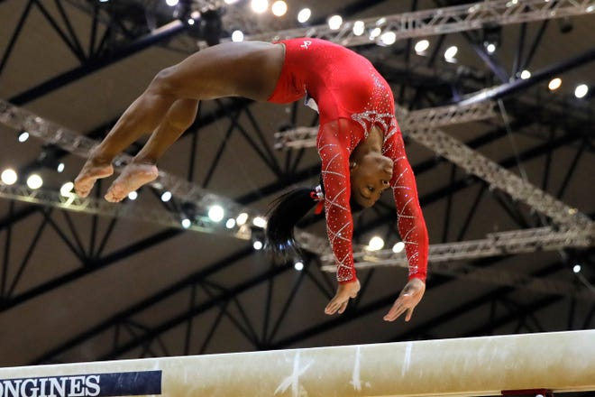 Bronze medalist Simone Biles of the U.S. performs on the balance beam on the second and last day of the apparatus finals of the Gymnastics World Championships at the Aspire Dome in Doha, Qatar, on Nov. 3.