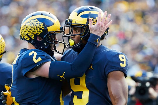 Michigan Wolverines wide receiver Donovan Peoples-Jones (9) receives congratulations from quarterback Shea Patterson (2) after a first0half touchdown against the Penn State Nittany Lions at Michigan Stadium.