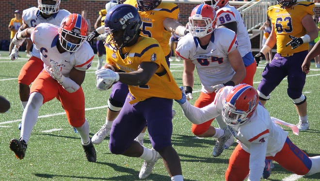 Louisiana College's T.J. Gray tries to make a tackle against UMHB Saturday.