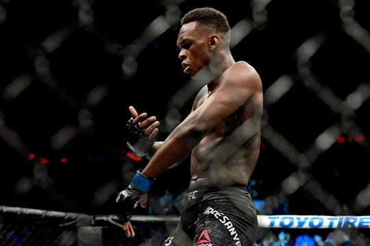 Israel Adesanya of Nigeria celebrates victory over Derek Brunson of the United States in their middleweight bout during the UFC 230 event at Madison Square Garden on November 3, 2018 in New York City.  (Photo by Steven Ryan/Getty Images)