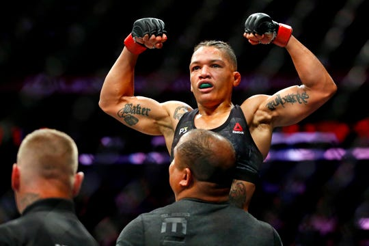 Sijara Eubanks (red gloves) celebrates beating Roxanne Modafferi (blue gloves) during UFC 230 at Madison Square Garden. Mandatory Credit: Noah K. Murray-USA TODAY Sports