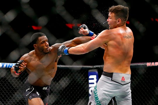 Karl Roberson (red gloves) fights Jack Marshman (blue gloves) during UFC 230 at Madison Square Garden. Mandatory Credit: Noah K. Murray-USA TODAY Sports