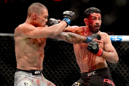 Sheymon Moraes of Brazil (L) fights against Julio Arce of the United States in their featherweight bout during the UFC 230 event at Madison Square Garden on November 3, 2018 in New York City.  (Photo by Steven Ryan/Getty Images)