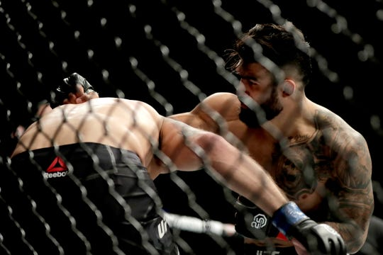 Lyman Good, right, throws a punch at Ben Saunders during the first round of a welterweight mixed martial arts bout at UFC 230, Saturday, Nov. 3, 2018, at Madison Square Garden in New York. (AP Photo/Julio Cortez)