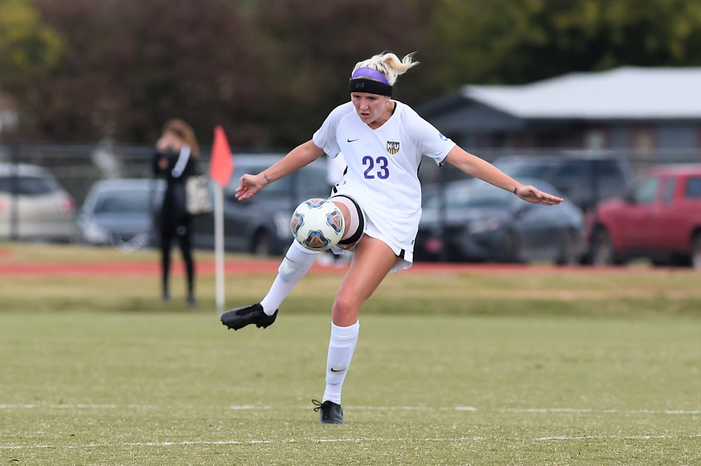 Hardin-Simmons defender Baylee Ford (23) settles the ball against Mary Hardin-Baylor in the American Southwest Conference tournament final. Ford transferred from Sam Houston State and filled a big role in the middle of the Cowgirls' back line.