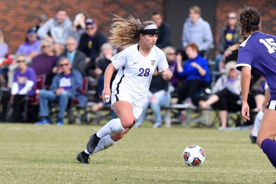Hardin-Simmons midfielder Kenne Kessler (28) takes on a Mary Hardin-Baylor defender in the American Southwest Conference tournament final on Sunday, Nov. 4, 2018, at the HSU Soccer Complex. The Cowgirls won their 16th straight ASC tournament with the 1-0 victory.