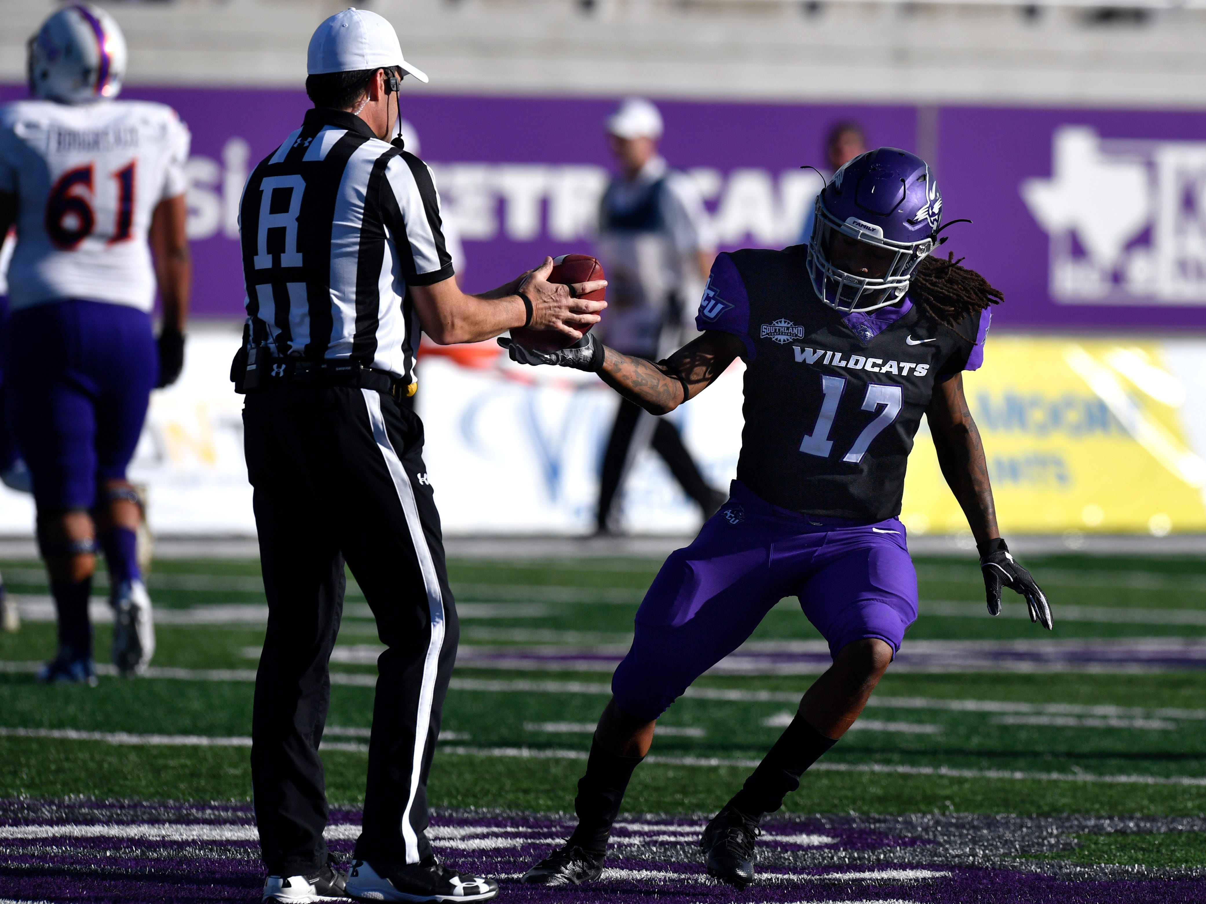 Abilene Christian's Jamar Mack hands the ball to an official after intercepting a Northwestern State pass and giving ACU control of the ball Saturday Nov. 3, 2018. Final score was 49-47, Abilene Christian University.