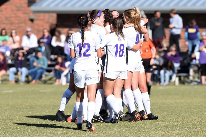 The Hardin-Simmons women's soccer team celebrates winning the American Southwest Conference tournament championship on Sunday, Nov. 4, 2018, at the HSU Soccer Complex. The Cowgirls won their 16th straight ASC tournament with the 1-0 victory.