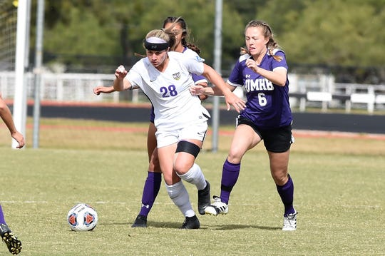 Hardin-Simmons midfielder Kenne Kessler (28) breaks away from a pair of Mary Hardin-Baylor defenders in the ASC tournament championship on Sunday at he HSU Soccer Complex. The Cowgirls won their 16th straight ASC tournament title with a 1-0 victory.