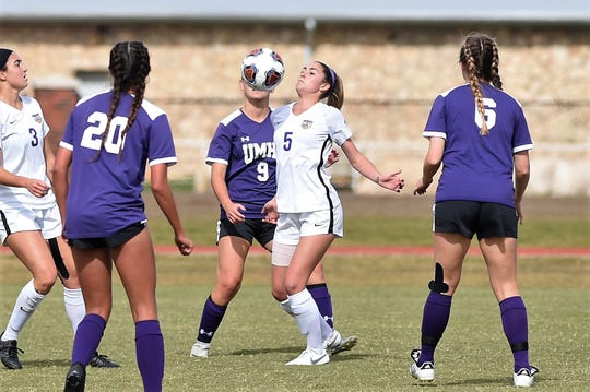 Hardin-Simmons midfielder Evan Pipkin (5) settles the ball surrounded by Mary Hardin-Baylor defenders in the ASC tournament championship on Sunday at he HSU Soccer Complex. The Cowgirls won their 16th straight ASC tournament with the 1-0 victory.