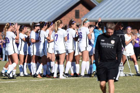 The Hardin-Simmons women's soccer team celebrates winning the American Southwest Conference tournament championship as head coach Marcus Wood walks off the field on Sunday, Nov. 4, 2018, at the HSU Soccer Complex. The Cowgirls won their 16th straight ASC tournament with the 1-0 victory.