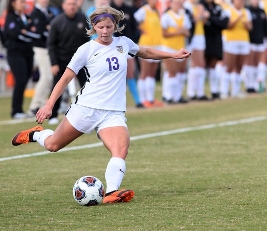 Hardin-Simmons midfielder Josey Meyer (13) takes a free kick against Mary Hardin-Baylor in the American Southwest Conference tournament final on Sunday, Nov. 4, 2018, at the HSU Soccer Complex. The Cowgirls won their 16th straight ASC tournament with the 1-0 victory.