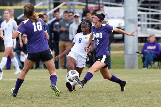 Hardin-Simmons forward Finda Kollie (6) battles Mary Hardin-Baylor's Sydney Rangel (2) in the ASC tournament championship on Sunday at he HSU Soccer Complex. The Cowgirls claimed their 16th straight ASC tournament title with a 1-0 win.