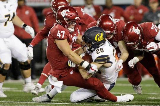 Washington State linebacker Peyton Pelluer (47) tackles California running back Patrick Laird (28). Pelluer had 10 tackles in the game.