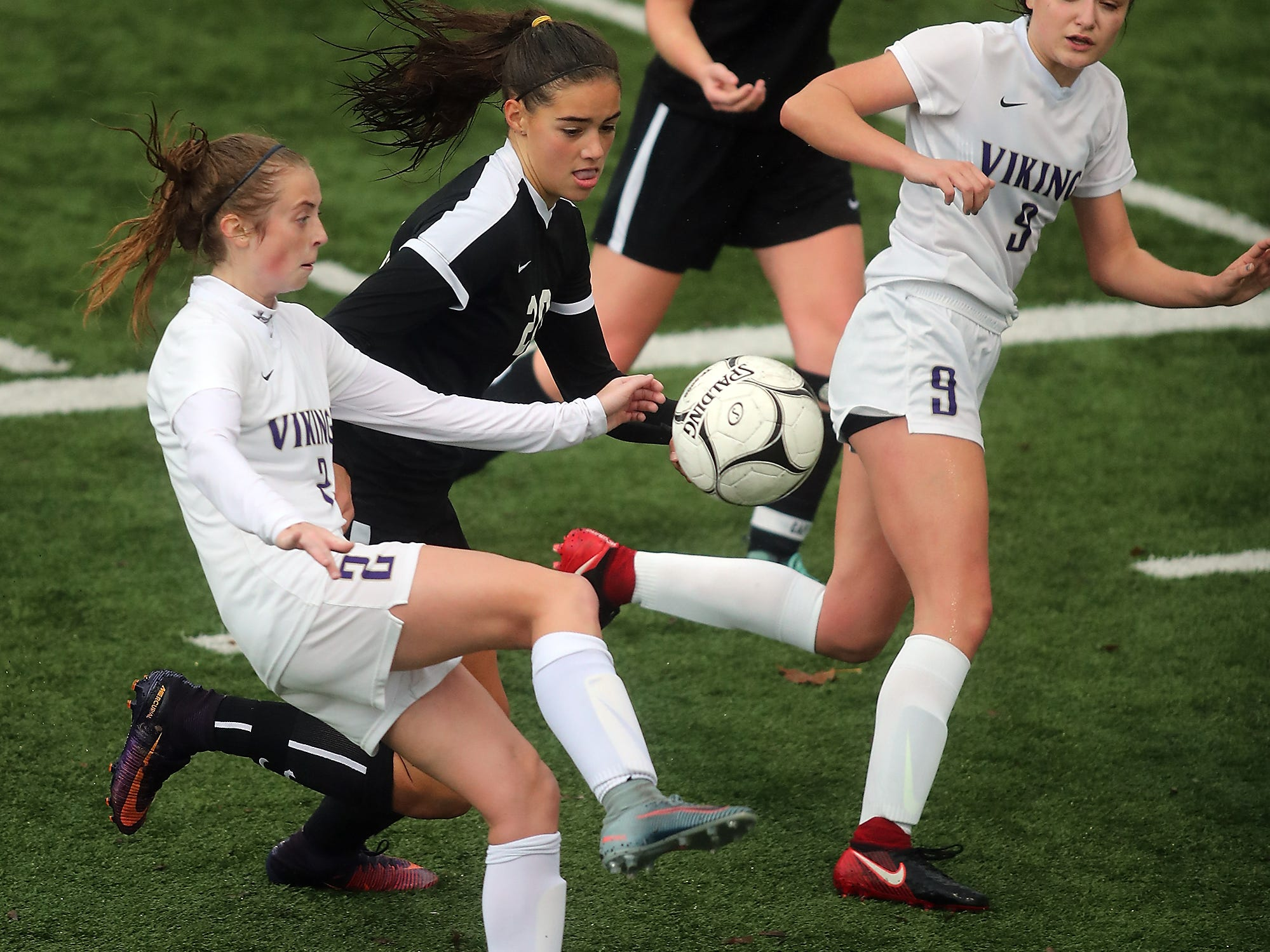 North Kitsap's Mia St.Peter (left) and Sequim's Hope Glasser battle for control of the ball at Silverdale Stadium on Saturday, November 3, 2018.