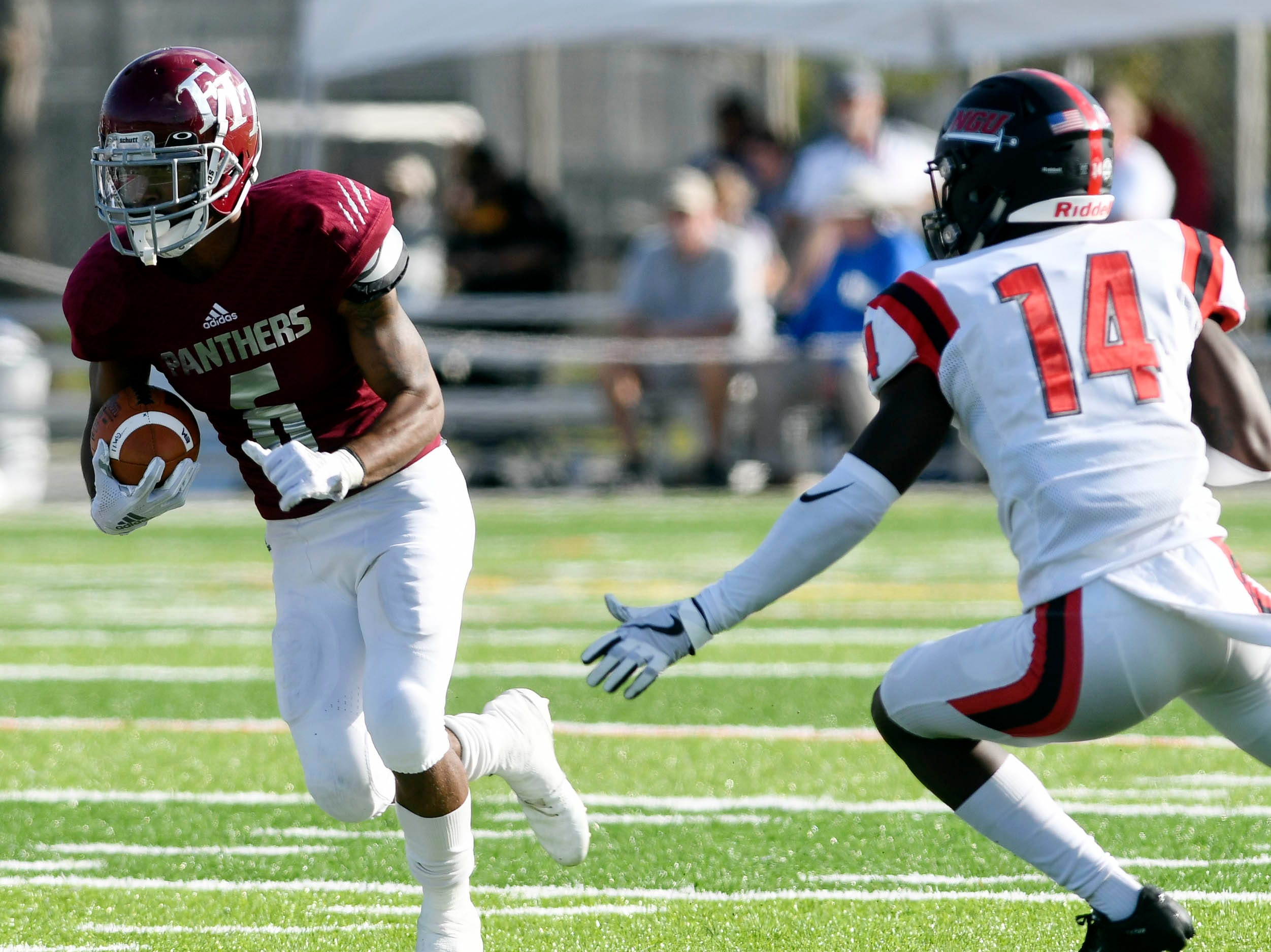 Antwuan Haynes of Florida Tech tries to get past North Greenville defender Johnny Worthy (14) during Saturday's game.