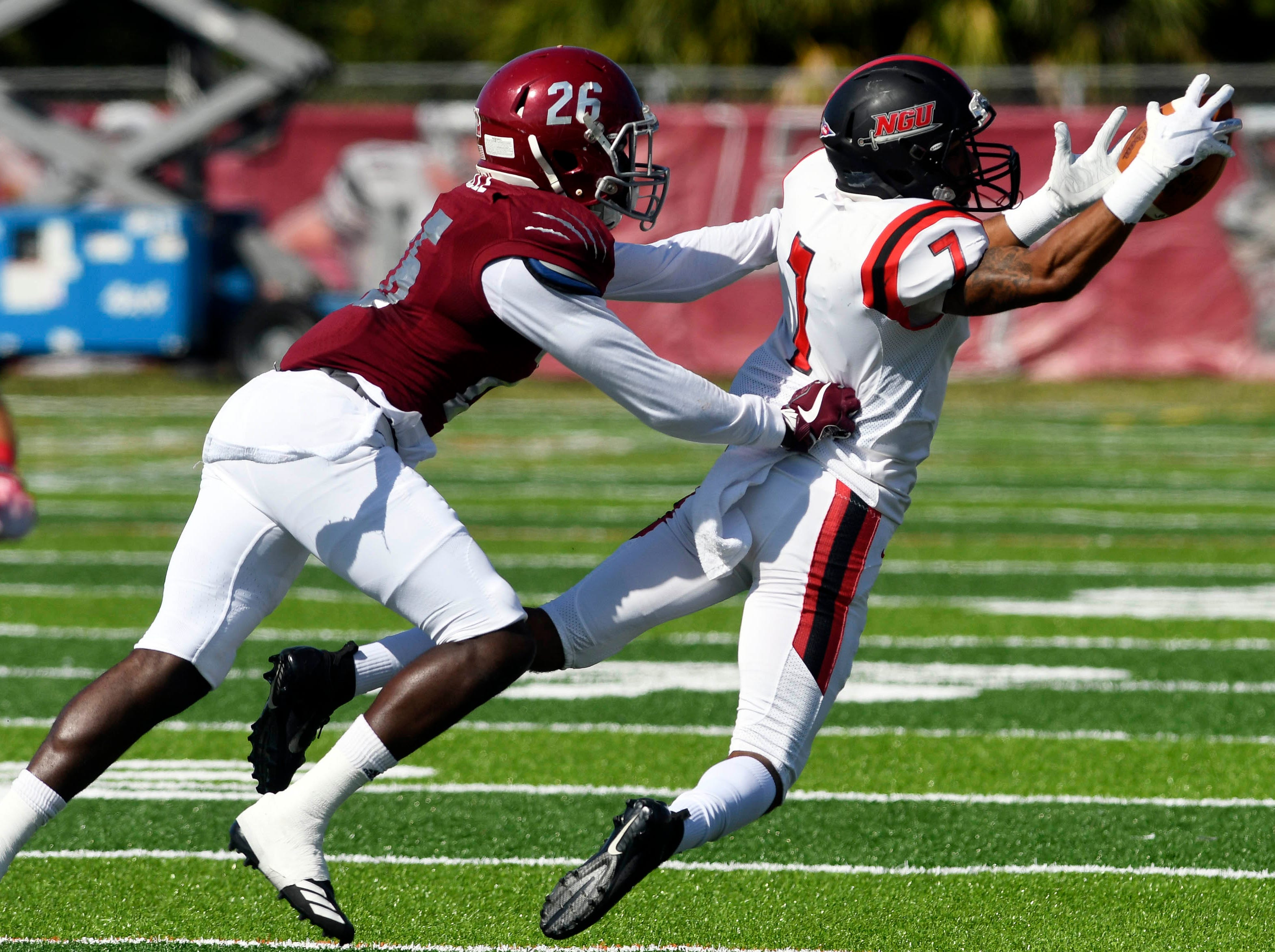 Demaijiay Rooks of North Greenville catches a pass in front of Florida Tech defender Richard Leveille during Saturday's game.