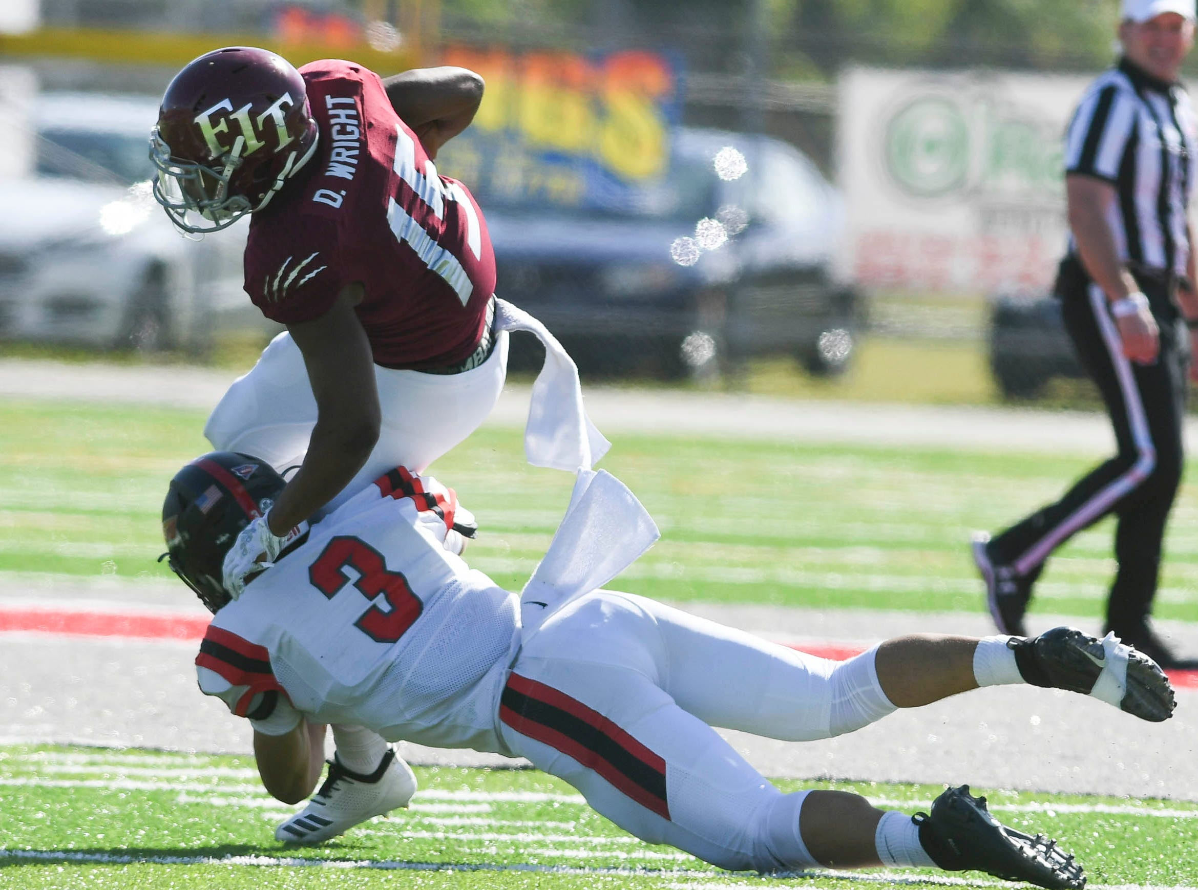 Derrick Wright of Florida Tech is brought down by Matthew Thomas of North Greenville during Saturday's game.