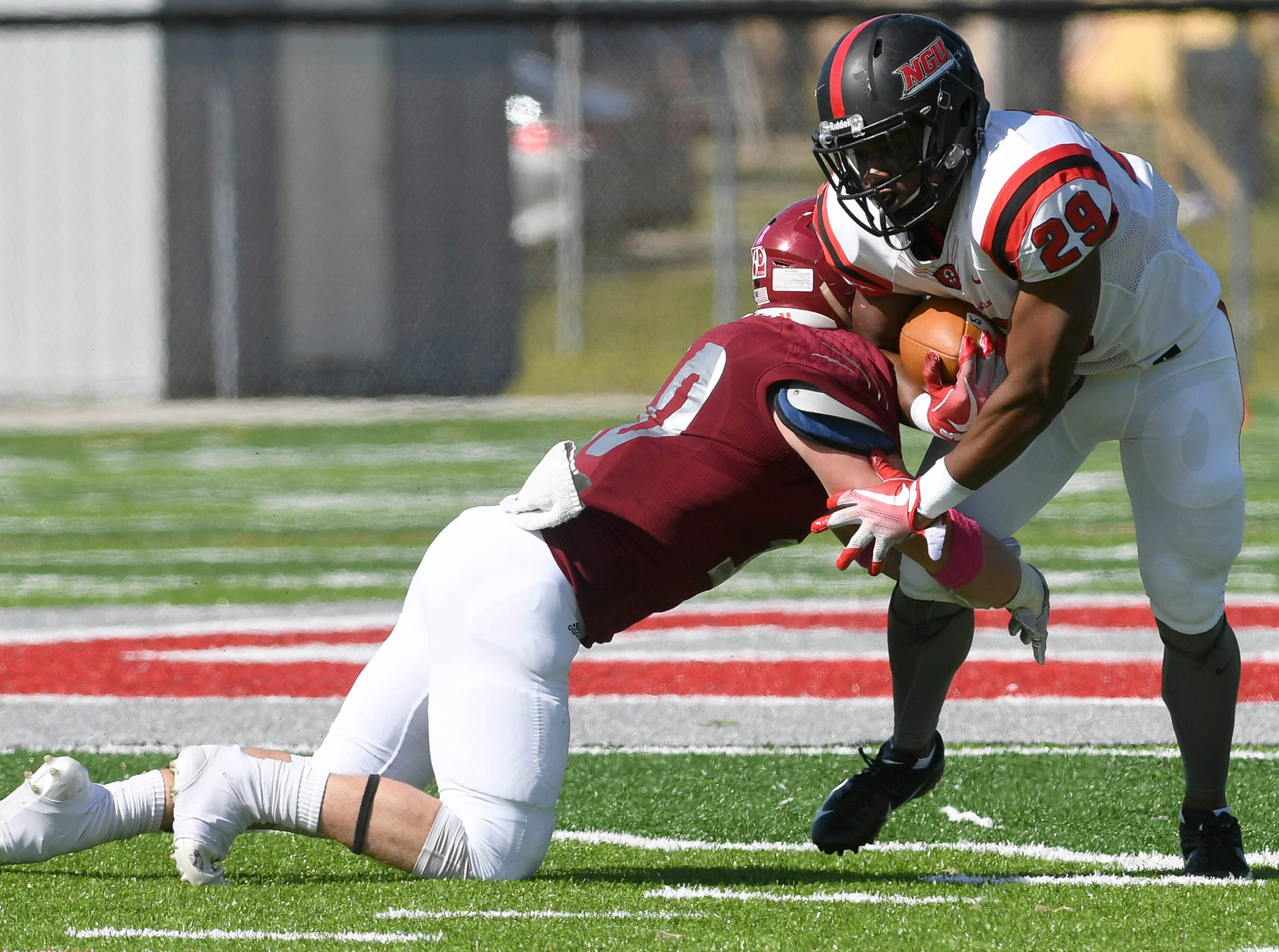 Florida Tech's Evan Thompson makes an open field tackle of North Greenville player EJ Humphrey during Saturday's game.