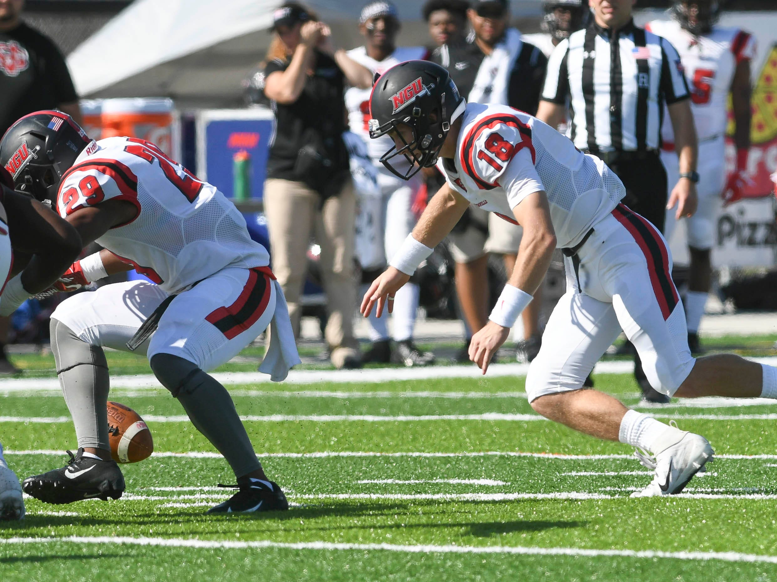 EJ Humphrey and Donnie Baker of North Greenville chase a fumble during Saturday's game.