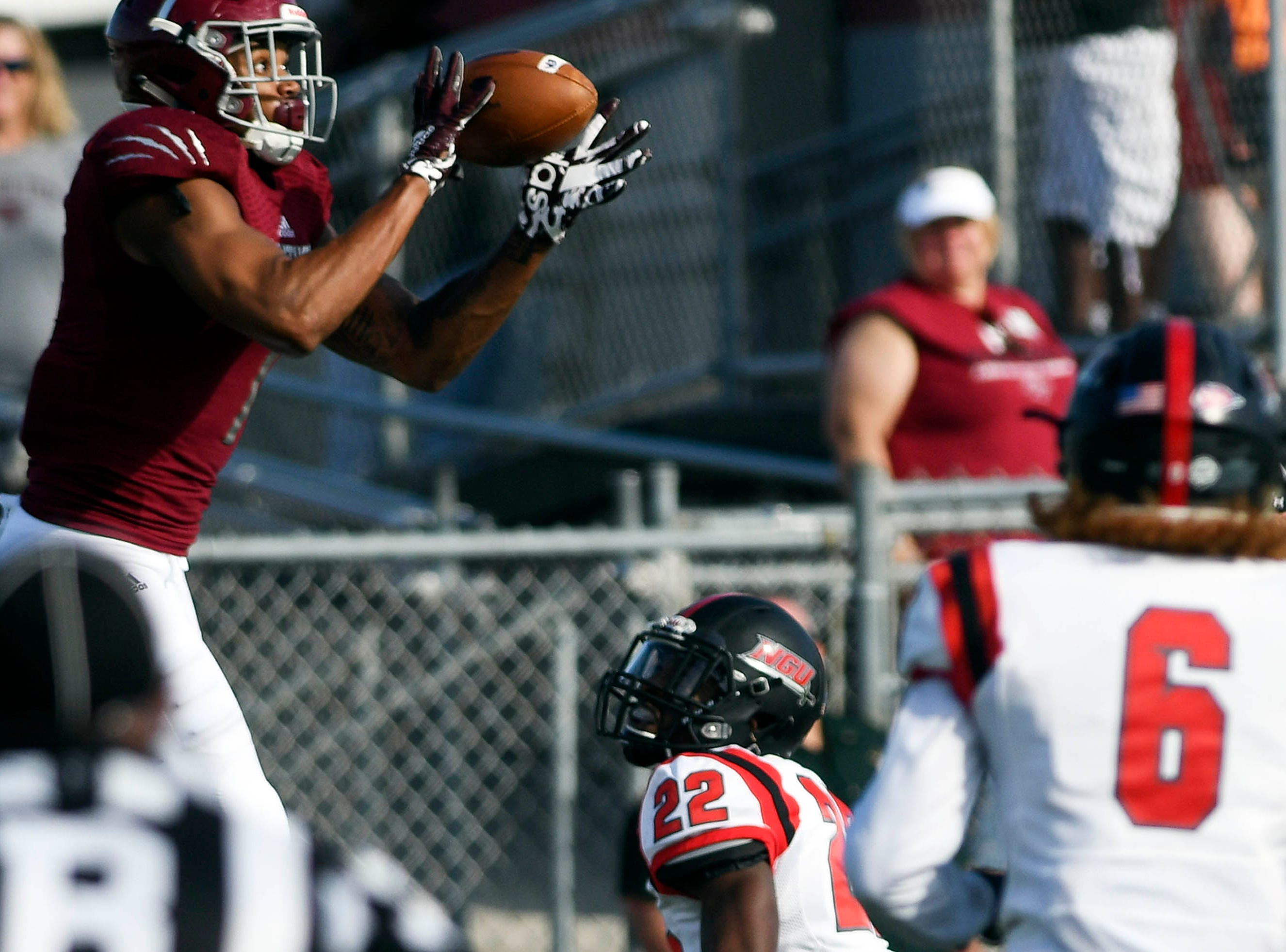 Terrance Bynum of Florida Tech catches a touchdown pass during Saturday's game against North Greenville.