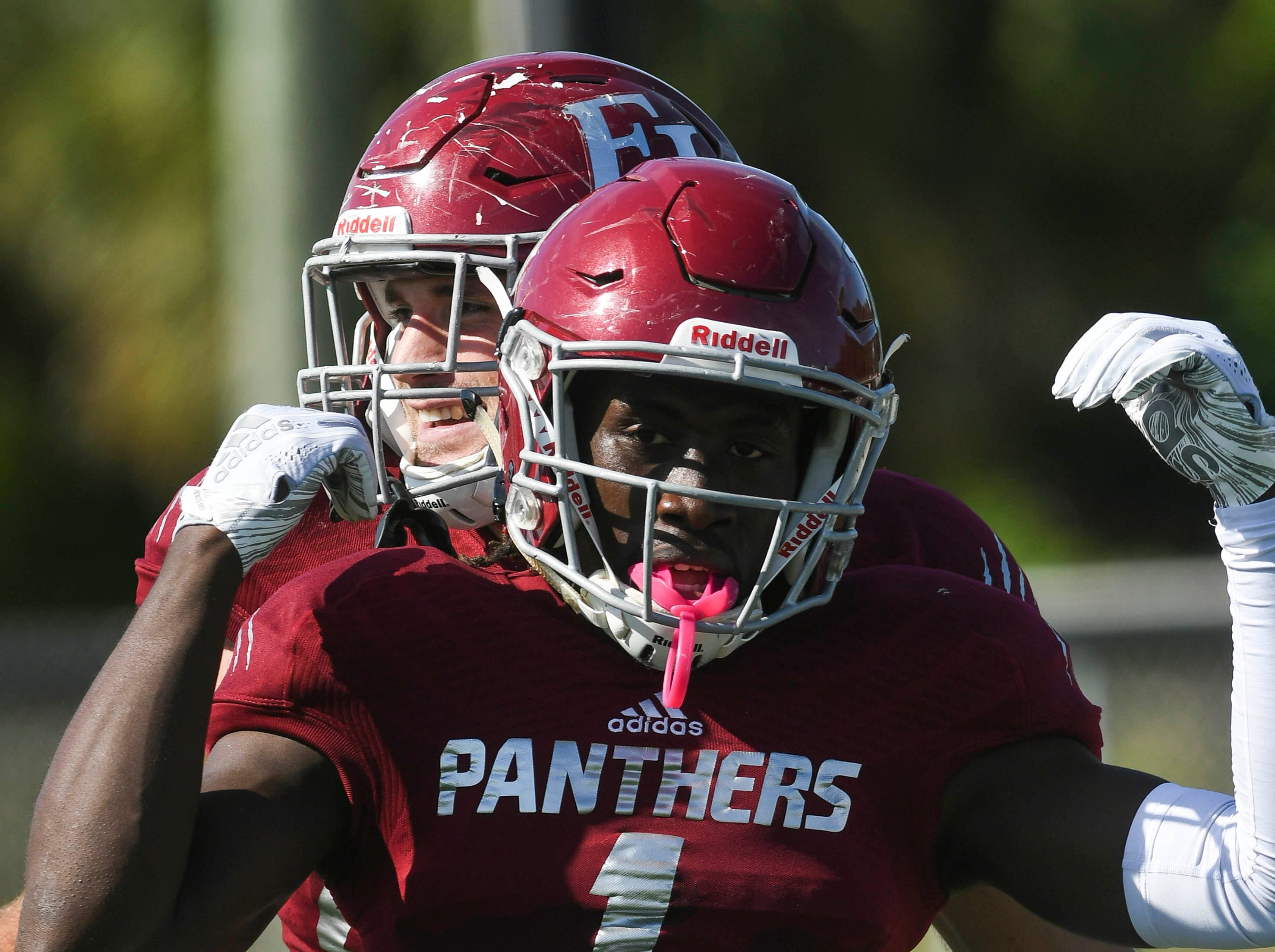 Romell Guerrier of Florida Tech celebrates a touchdown with teammates during Saturday's game.