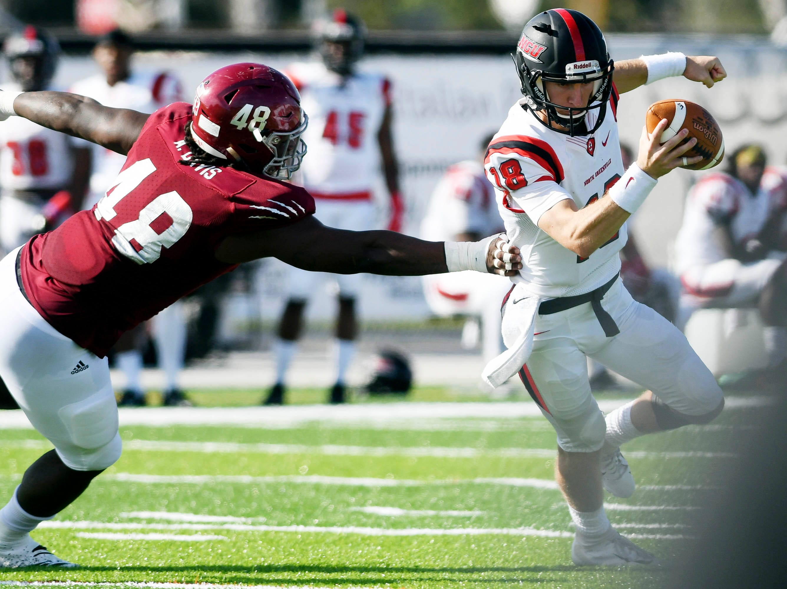 Adonis Davis of Florida Tech pursues North Greenville QB Donnie Baker during Saturday's game.