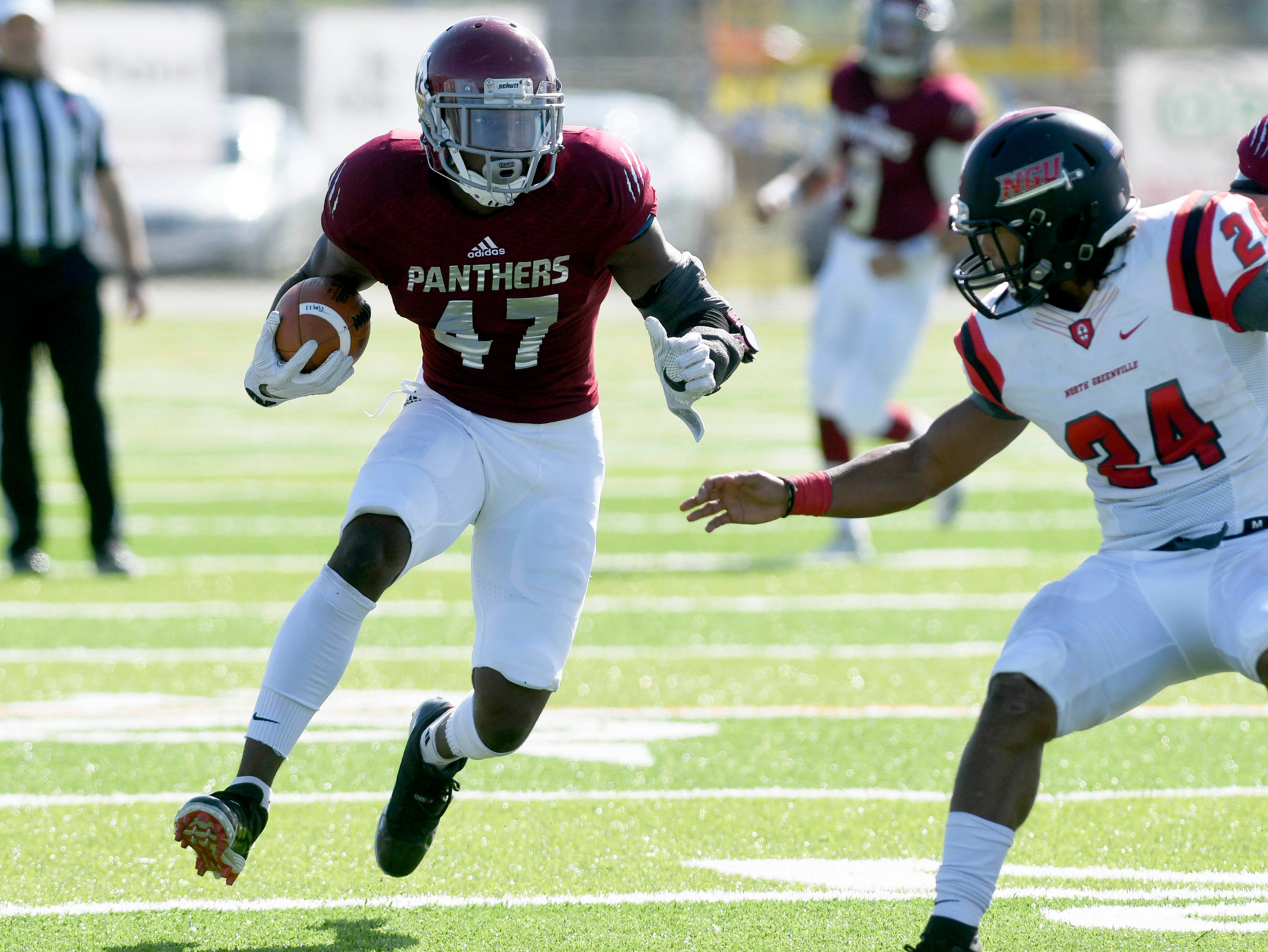 Damien McGhee of Florida Tech (47) tries to get around North Greenville defender Dominique Hunt during Saturday's game.
