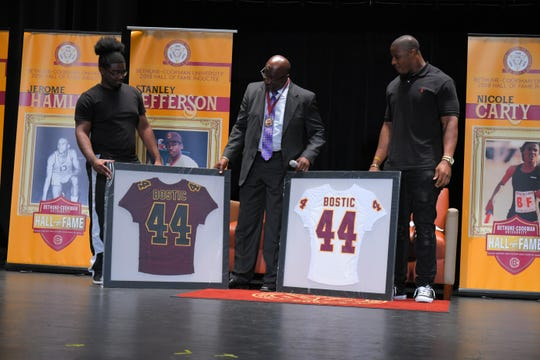 Jonathan Bostic, right, being inducted into Bethune Cookman University Hall of Fame.