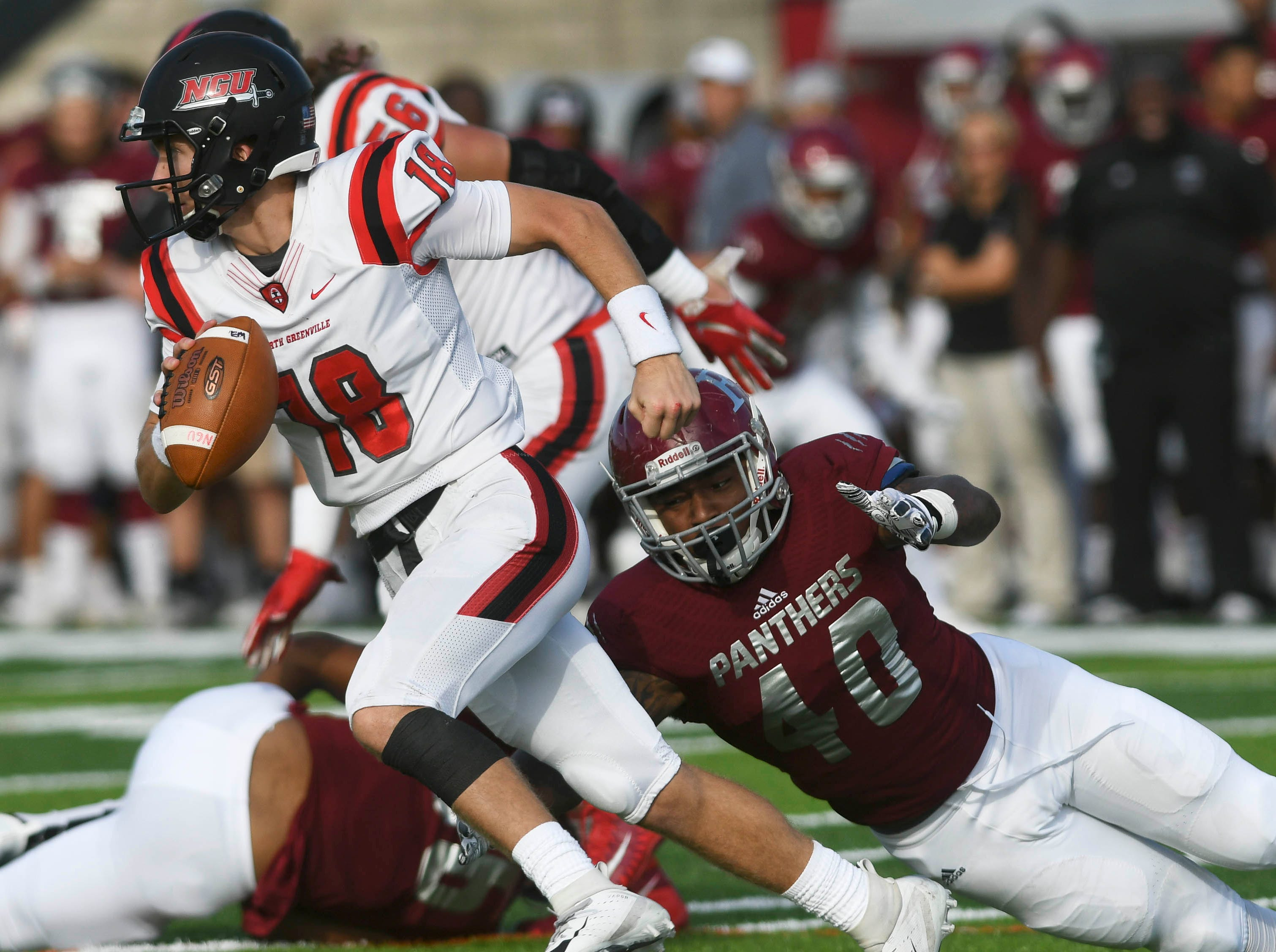 North Greenville QB Donnie Baker is sacked by Shyquan Barnes of Florida Tech during Saturday's game.