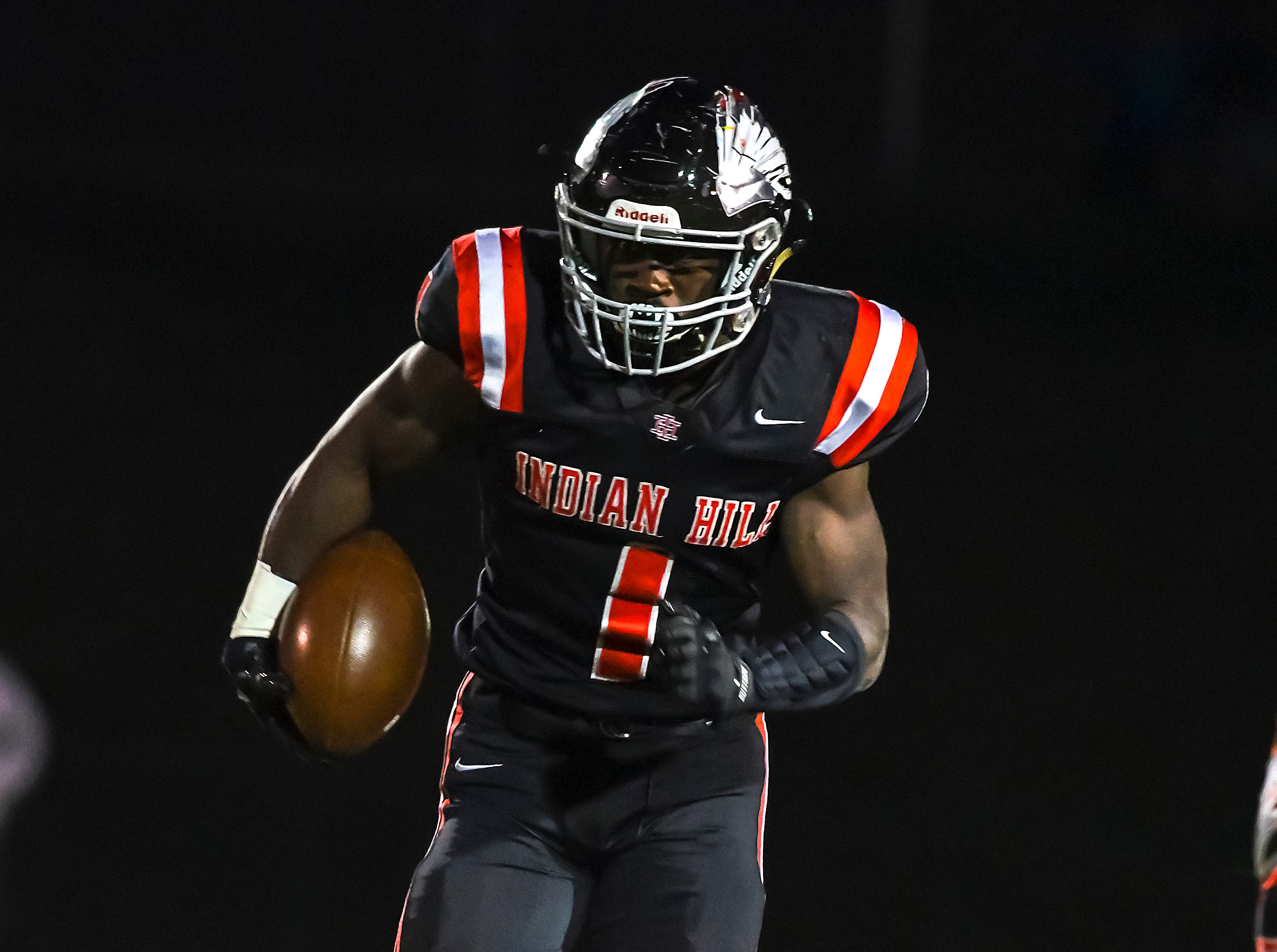 Dimetrious Baylor of Indian Hill runs the ball on the opening series of the game against Waverly in the OHSAA D4 Region 16 Playoffs at Indian Hill High School, Saturday, Nov. 3, 2018