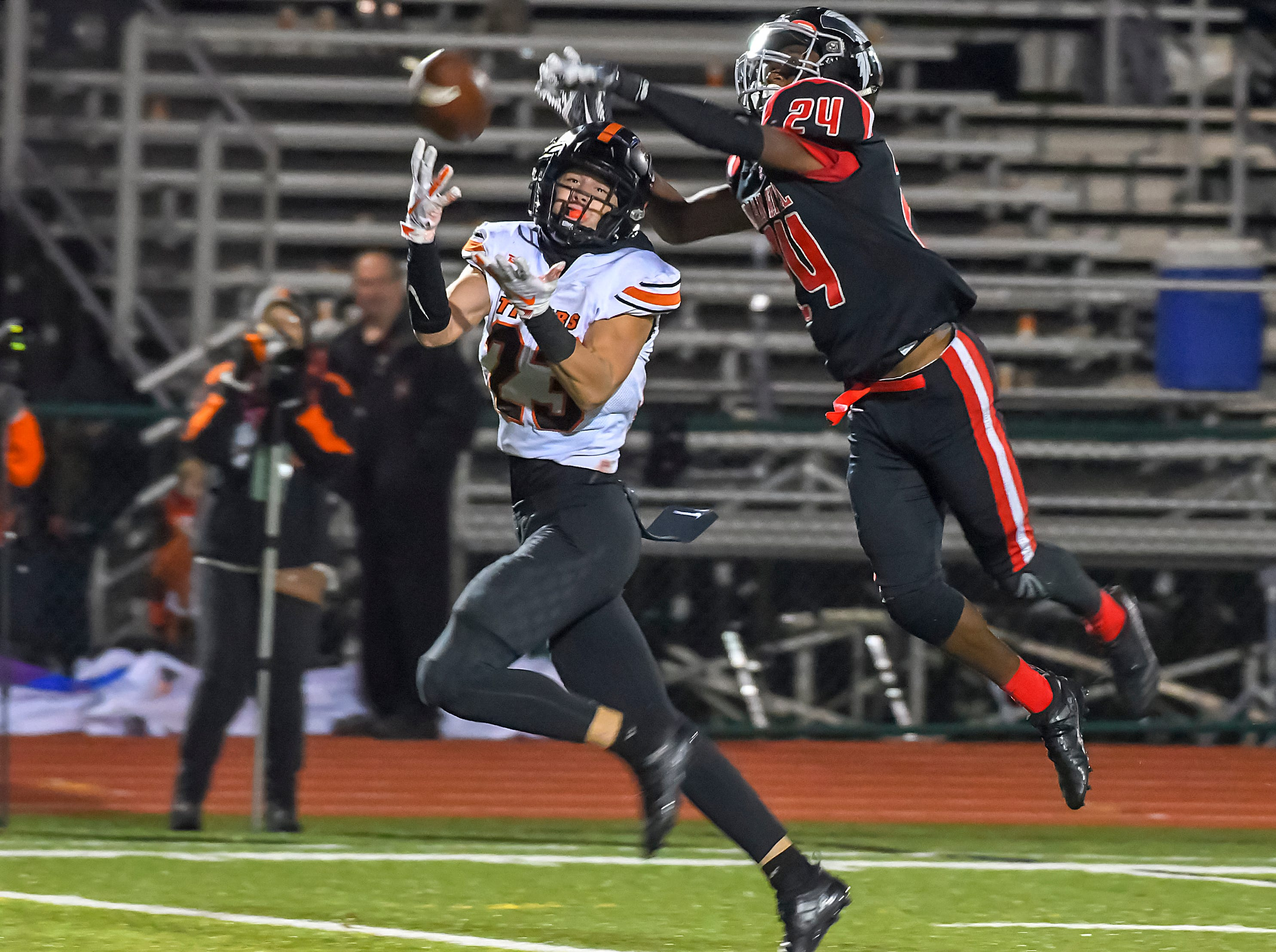 Easton Wolf of Waverly (23) cannot come up with a catch defended by Amari Whitehead of Indian Hill in the OHSAA D4 Region 16 Playoffs at Indian Hill High School, Saturday, Nov. 3, 2018