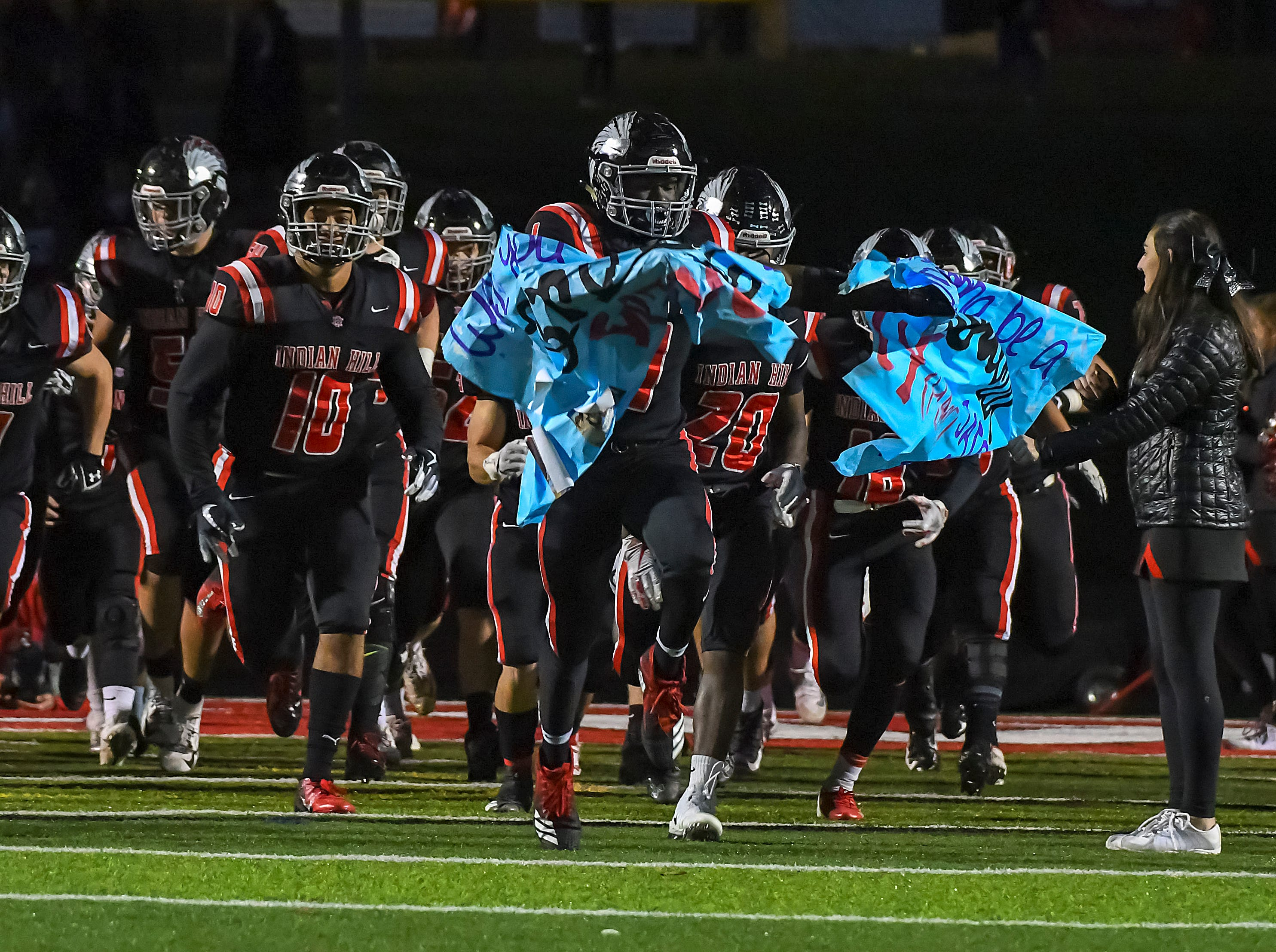 Indian Hill runs onto the field for their game against Waverly in the OHSAA D4 Region 16 Playoffs at Indian Hill High School, Saturday, Nov. 3, 2018