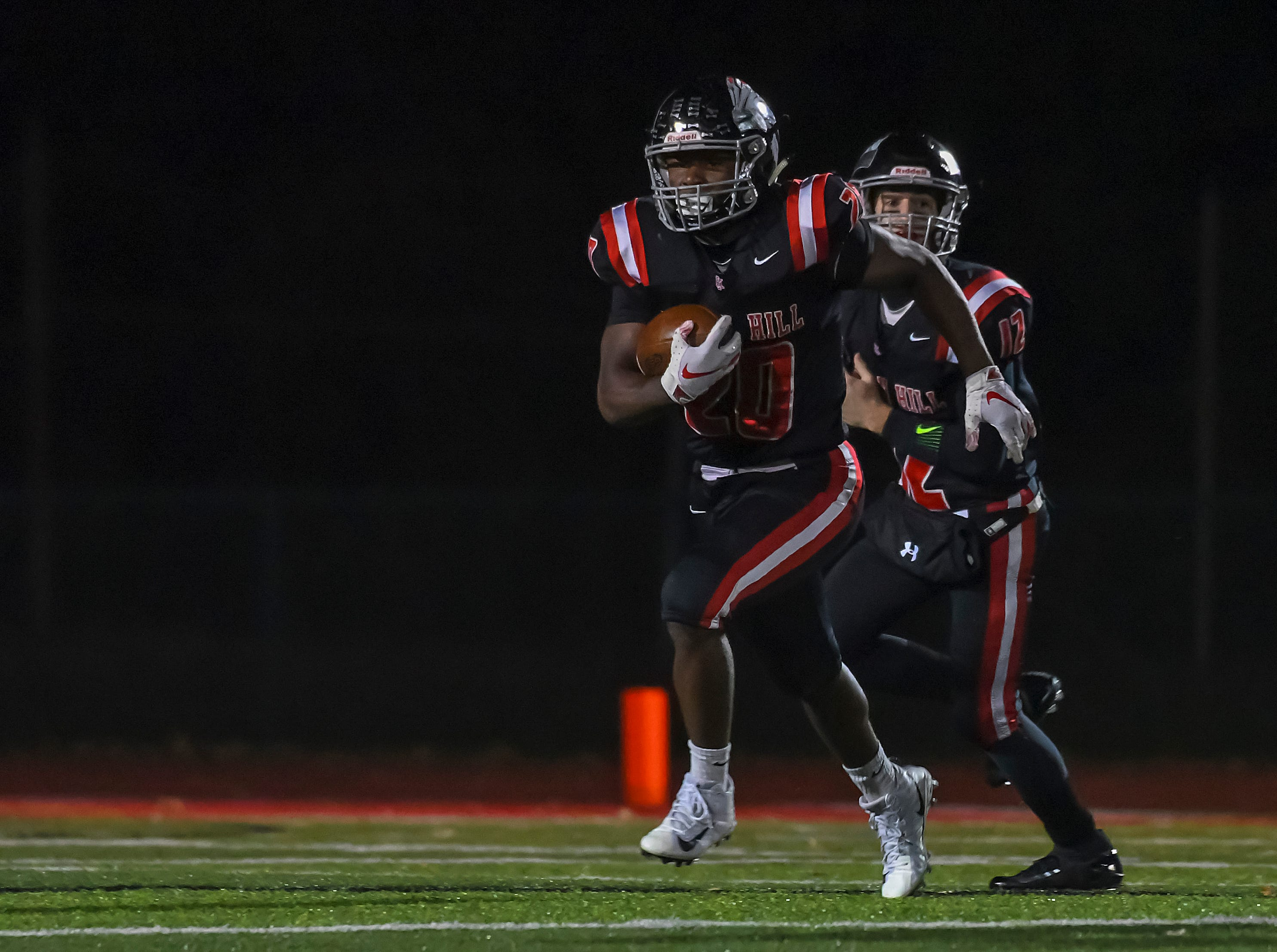 John Mark Williams (20) of Indian Hill runs the ball against Waverly in the OHSAA D4 Region 16 Playoffs at Indian Hill High School, Saturday, Nov. 3, 2018
