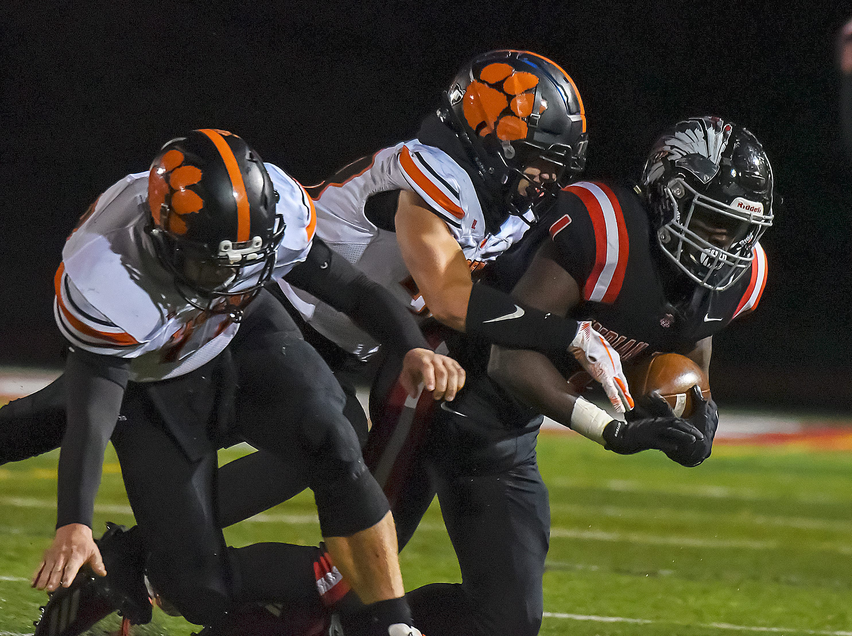 Dimetrious Baylor (1) of Indian Hill is tackled by Waverly defenders in the OHSAA D4 Region 16 Playoffs at Indian Hill High School, Saturday, Nov. 3, 2018