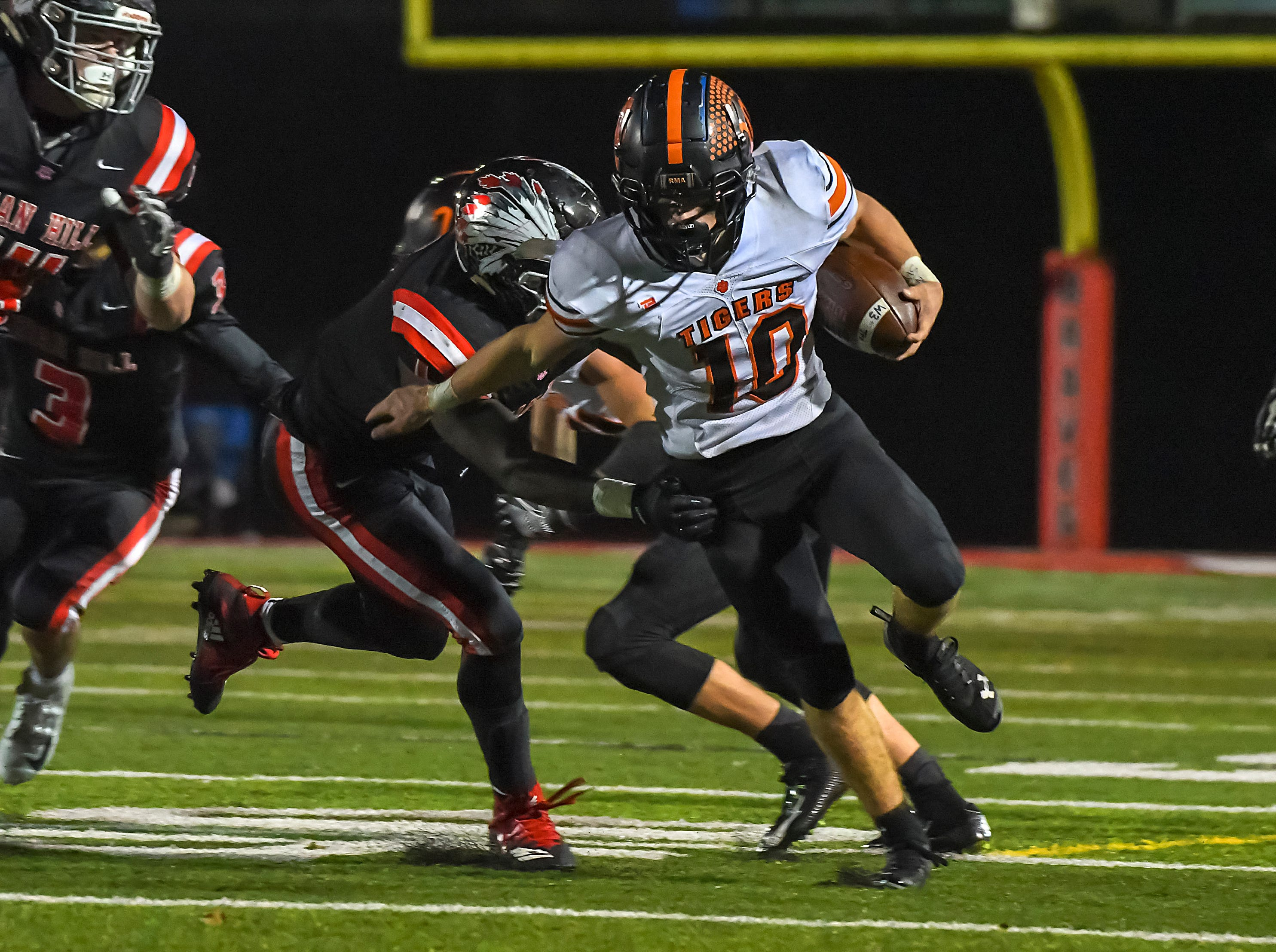 Payton Shoemaker (10) of Waverly runs past Indian Hill defenders in the OHSAA D4 Region 16 Playoffs at Indian Hill High School, Saturday, Nov. 3, 2018