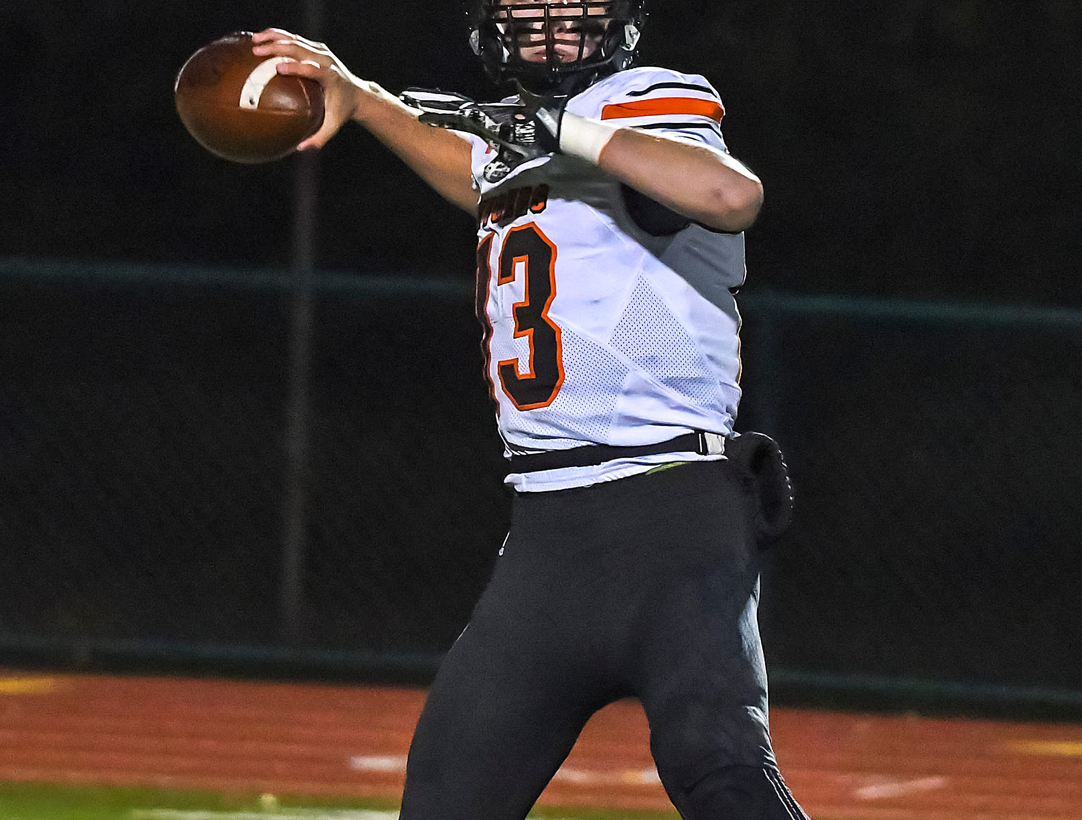 Haydn' Shanks of Waverly attempts a pass against Indian Hill in the OHSAA D4 Region 16 Playoffs at Indian Hill High School, Saturday, Nov. 3, 2018