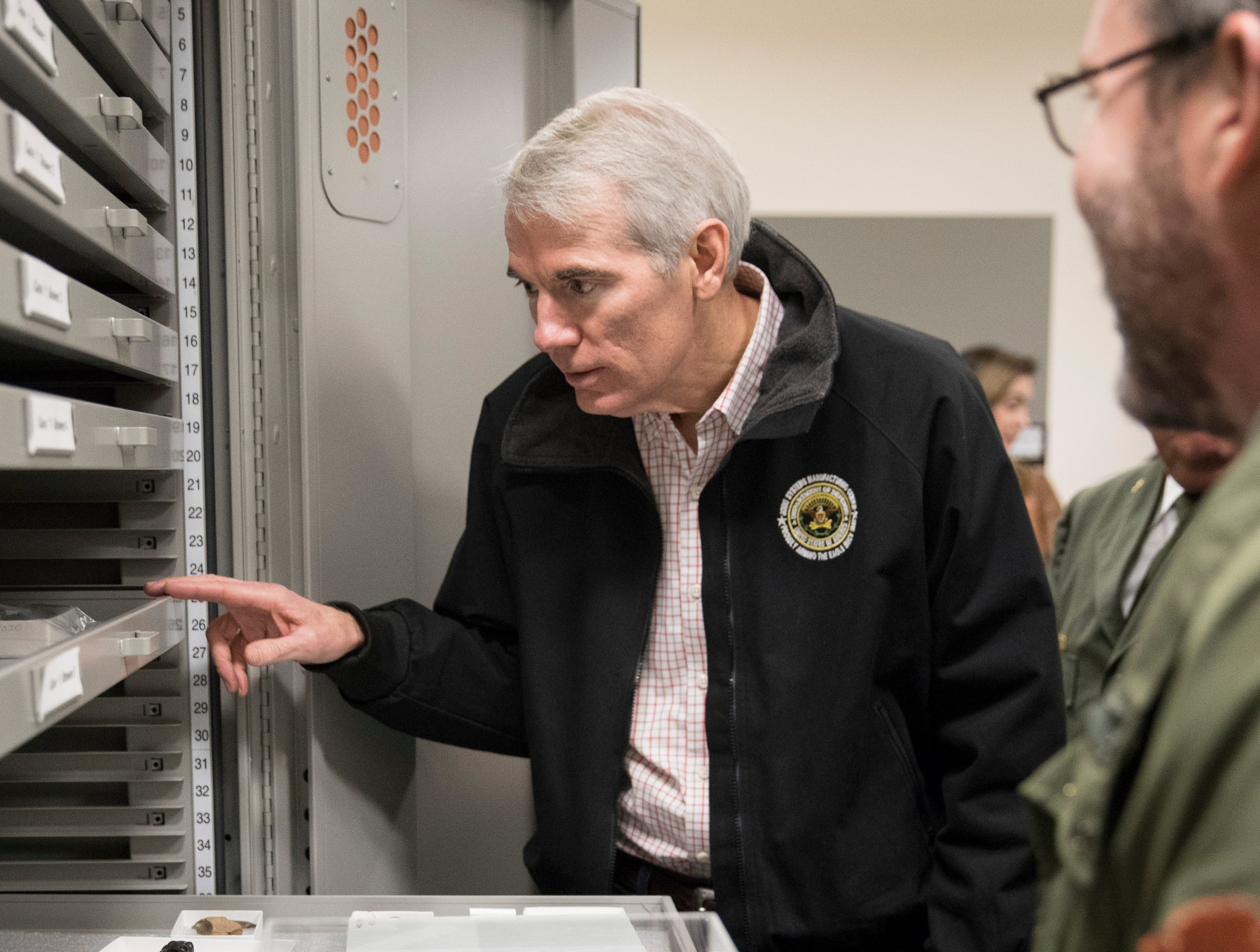 Senator Rob Portman checks out some of the artifacts kept at the Hopewell Culture National Historical Park Friday morning in Chillicothe, Ohio.
