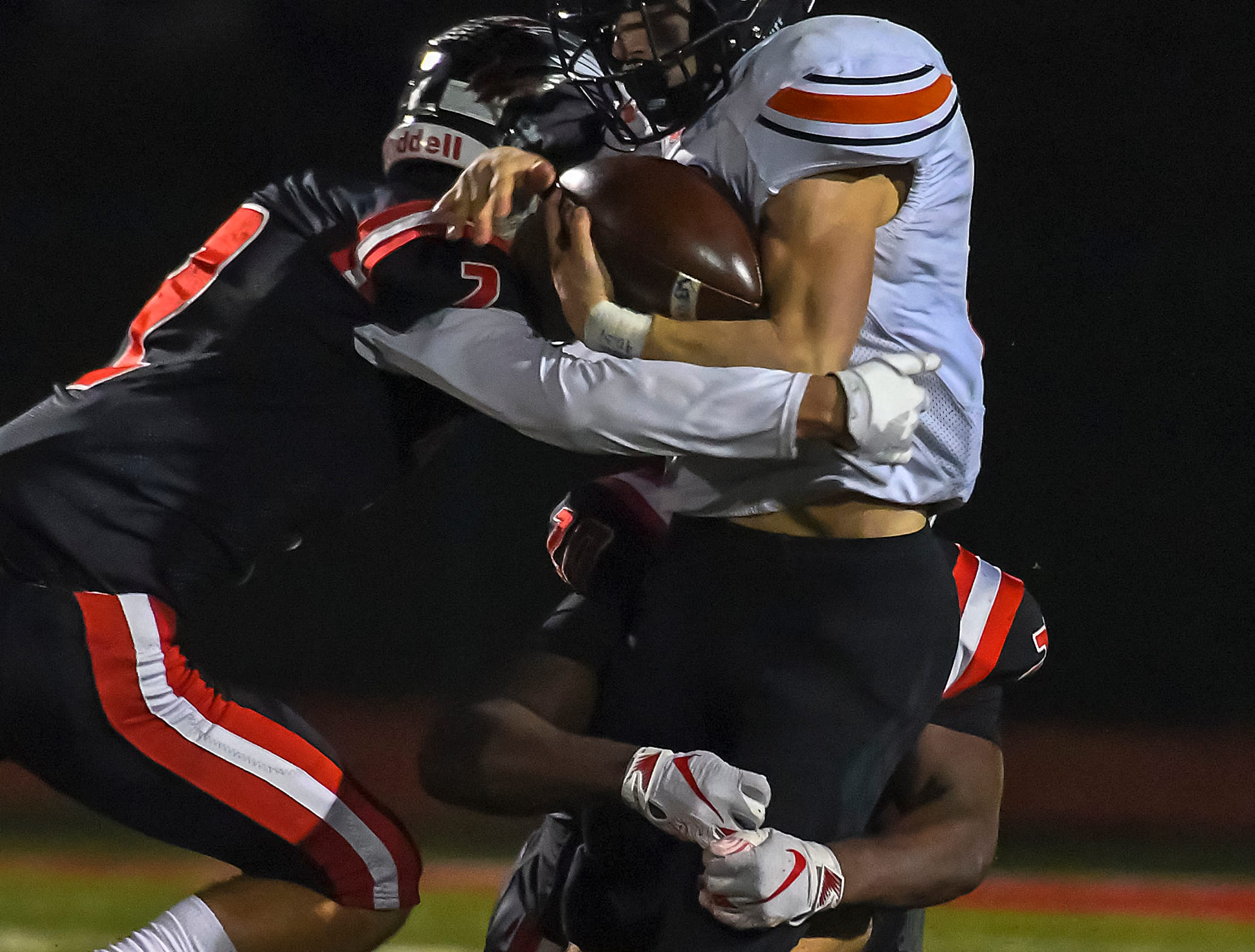 Payton Shoemaker (10) of Waverly is tackeled by Indian Hill defenders in the OHSAA D4 Region 16 Playoffs at Indian Hill High School, Saturday, Nov. 3, 2018