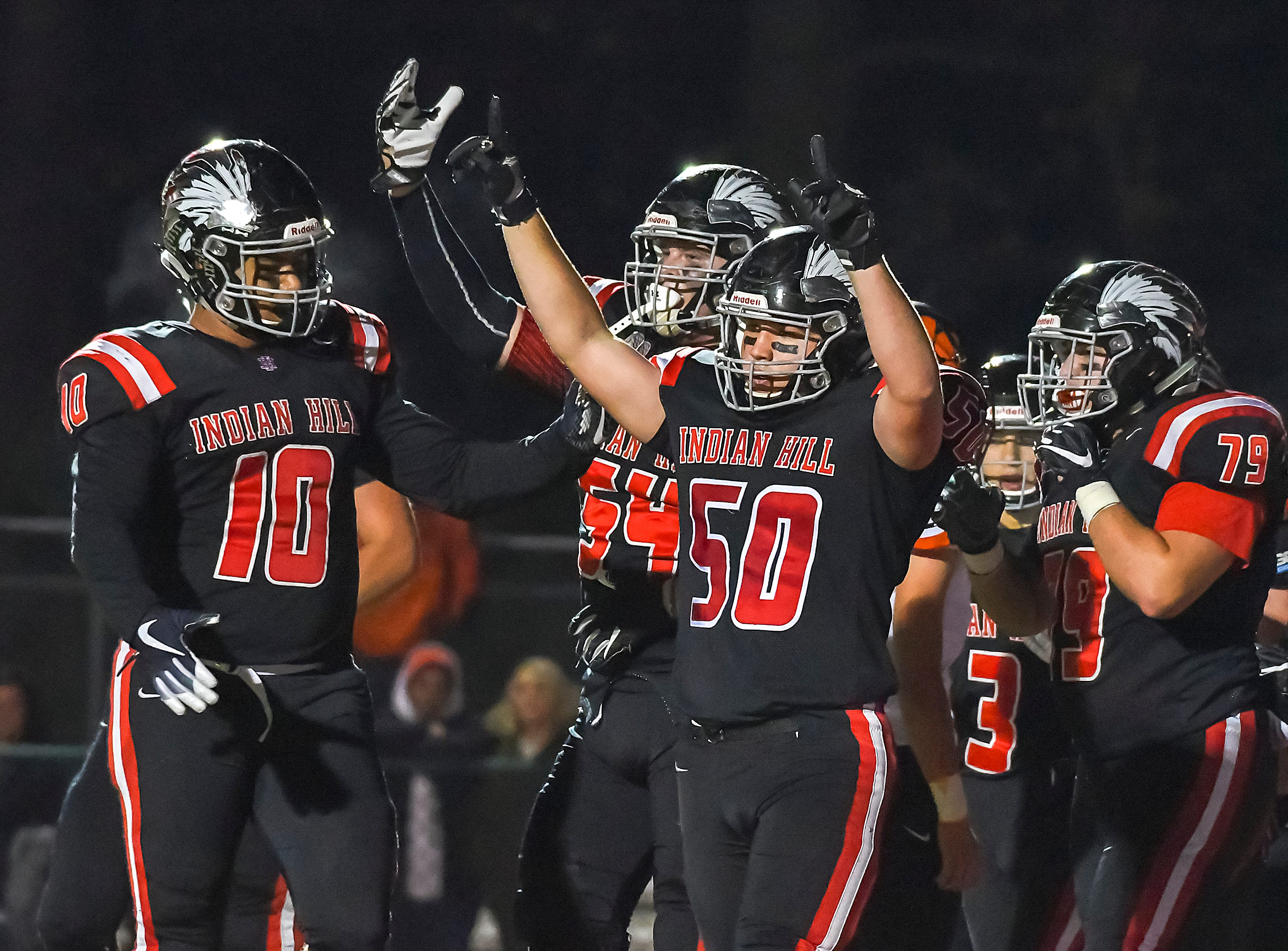 Indian Hill olayers celebrate after a Braves touchdoen against Waverly in the OHSAA D4 Region 16 Playoffs at Indian Hill High School, Saturday, Nov. 3, 2018