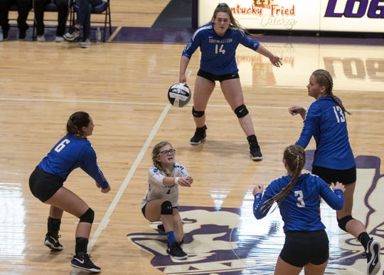 Freshman Lexie Lockwood gets ready to return a ball to Tuscarawas Valley Saturday afternoon as her teammates watch to intervene if needed. The Panthers fell 3-1 during the Division III regional final.