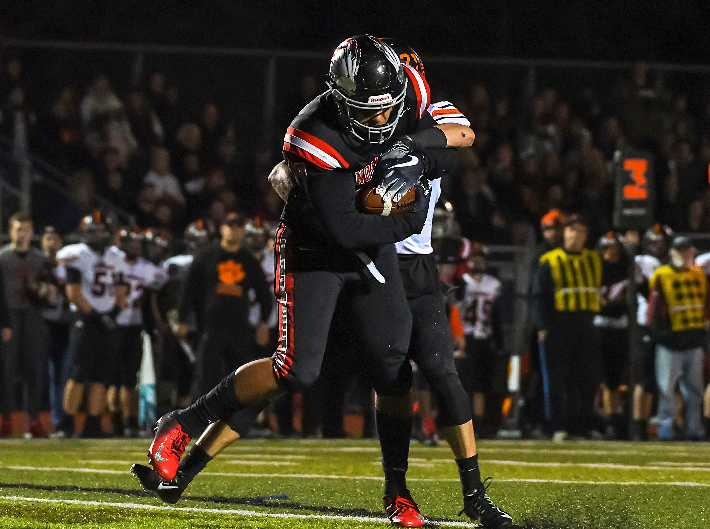 Jack Sichel of Indian Hill catches a pass against Waverly in the OHSAA D4 Region 16 Playoffs at Indian Hill High School, Saturday, Nov. 3, 2018